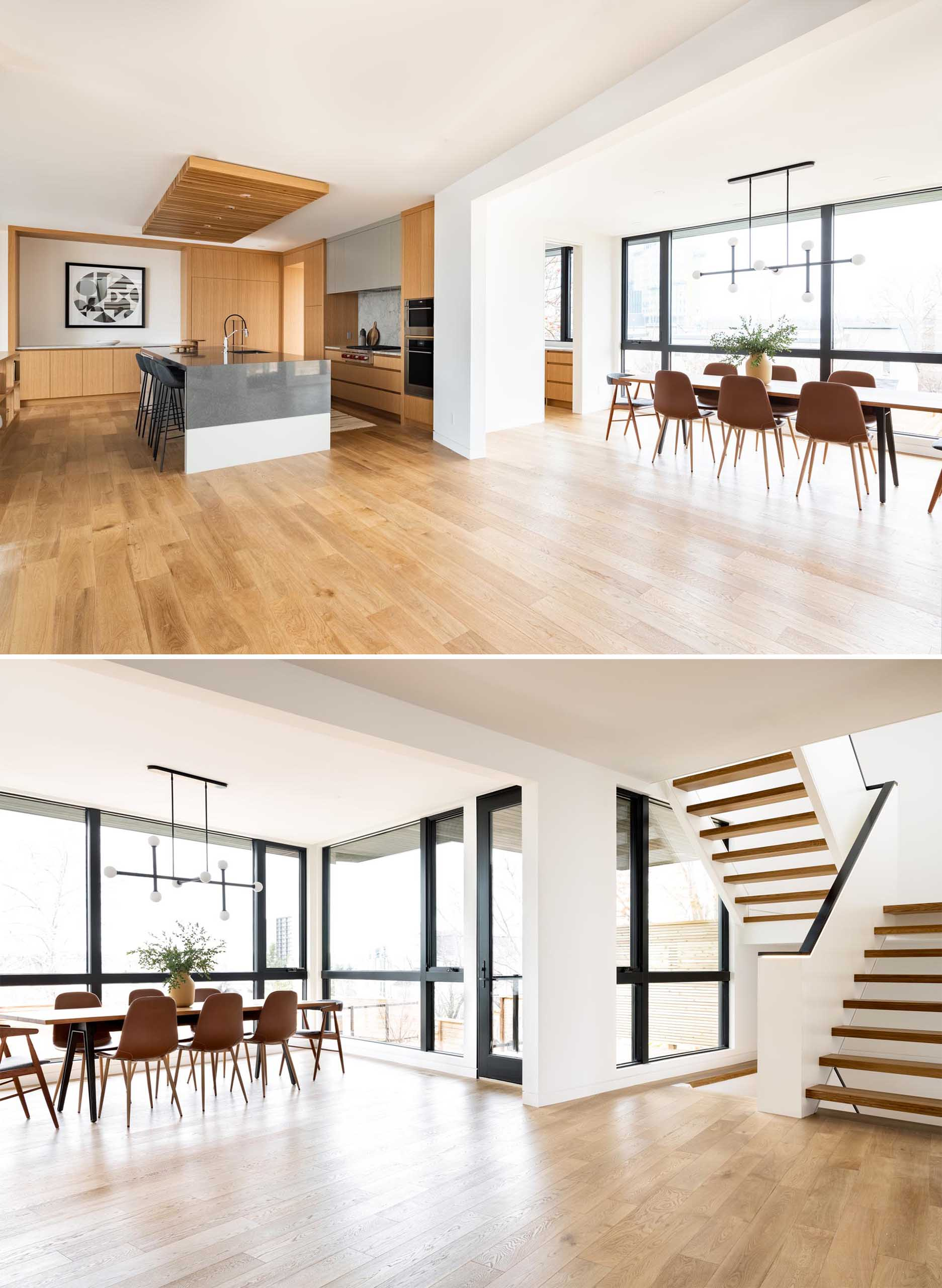 This open plan dining room is furnished with a long wood dining table with a sculptural horizontal light hanging above.