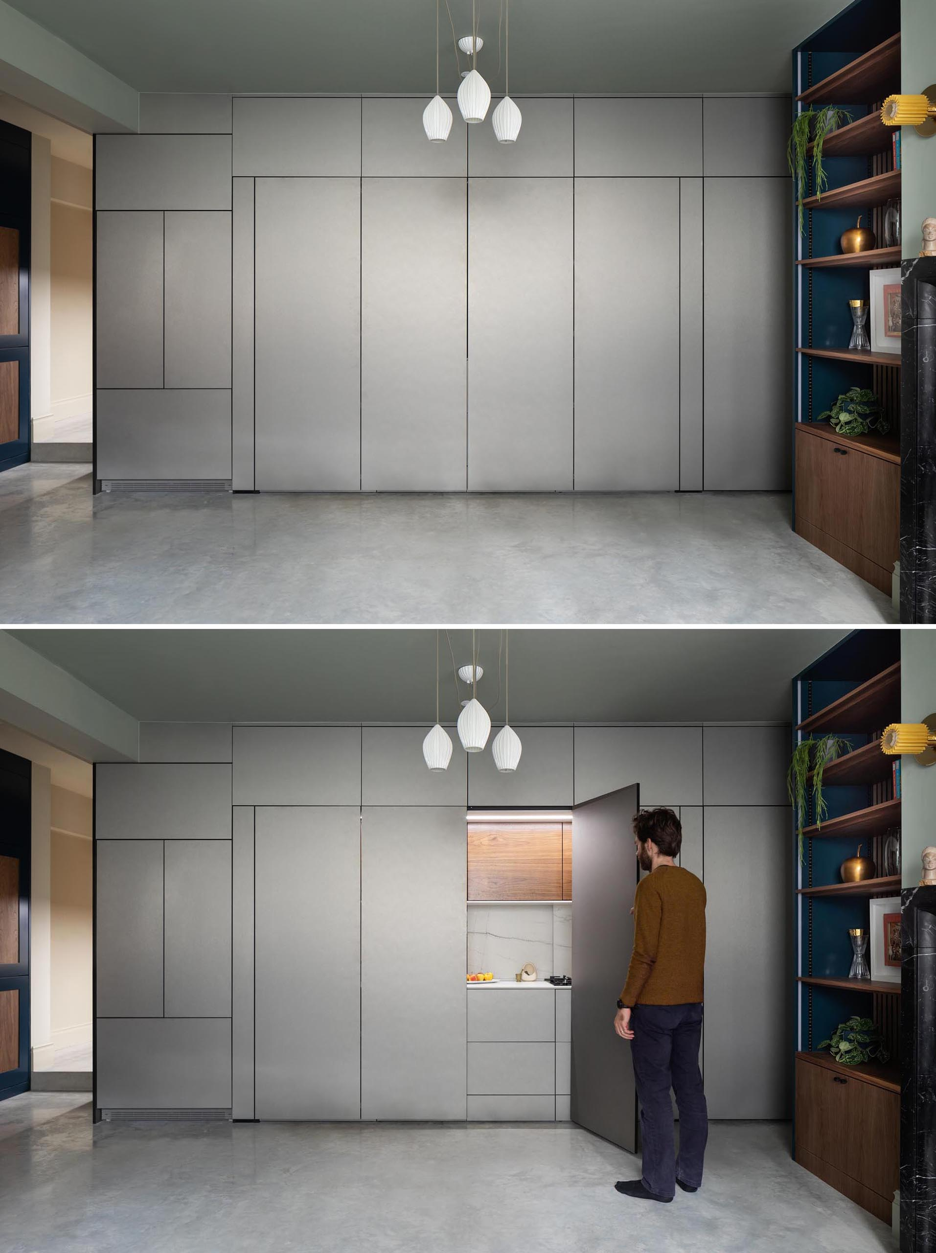 This modern kitchen, which can hidden away when not in use, is enclosed in muted metallic gray cabinets. The main section of the kitchen is accessed via a pair of folding doors.