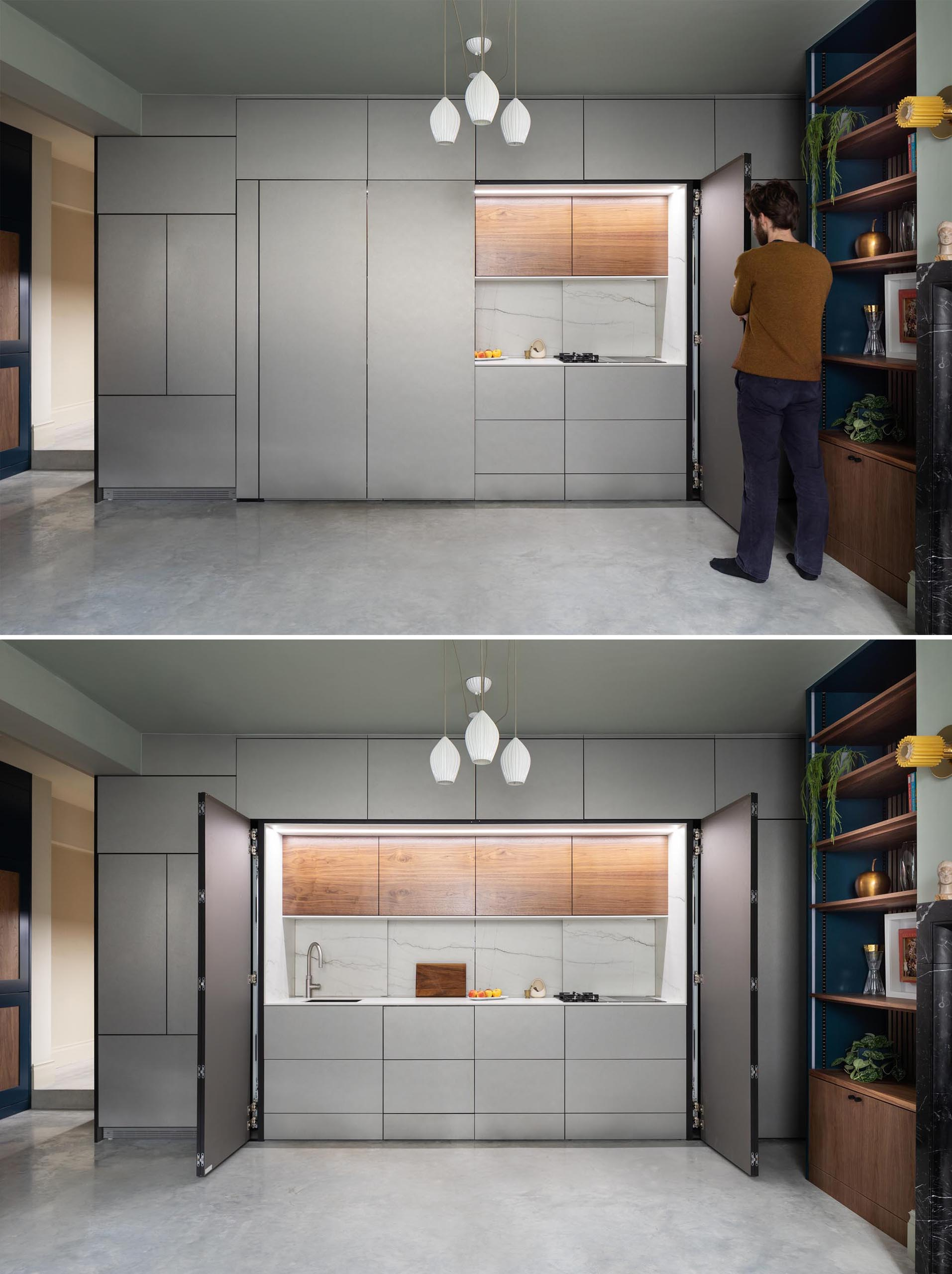 This kitchen, which can hidden away when not in use, is enclosed in muted metallic gray cabinets. The main section of the kitchen is accessed via a pair of folding doors.