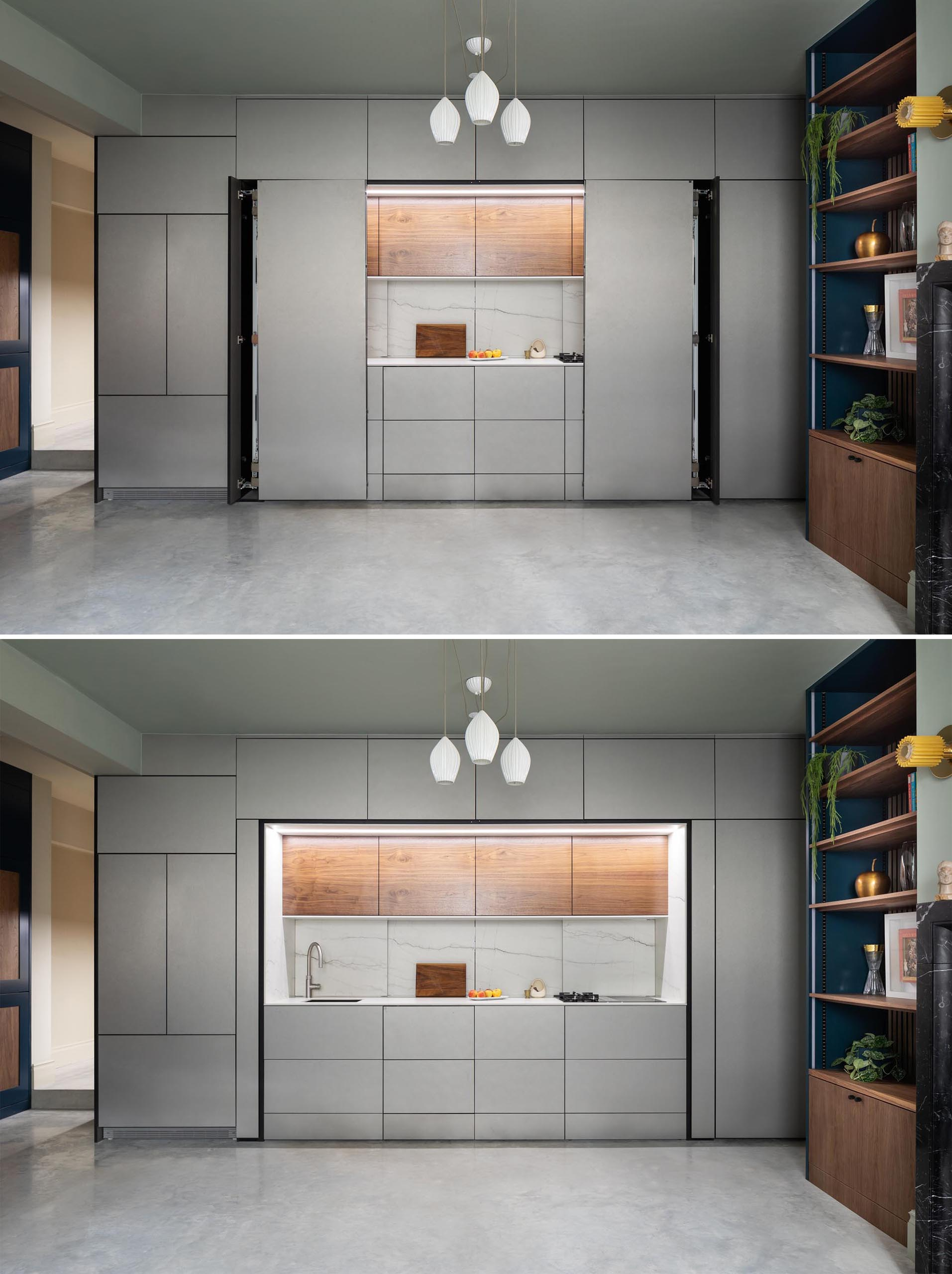 The folding doors of this modern kitchen can be completely hidden within the cabinetry.