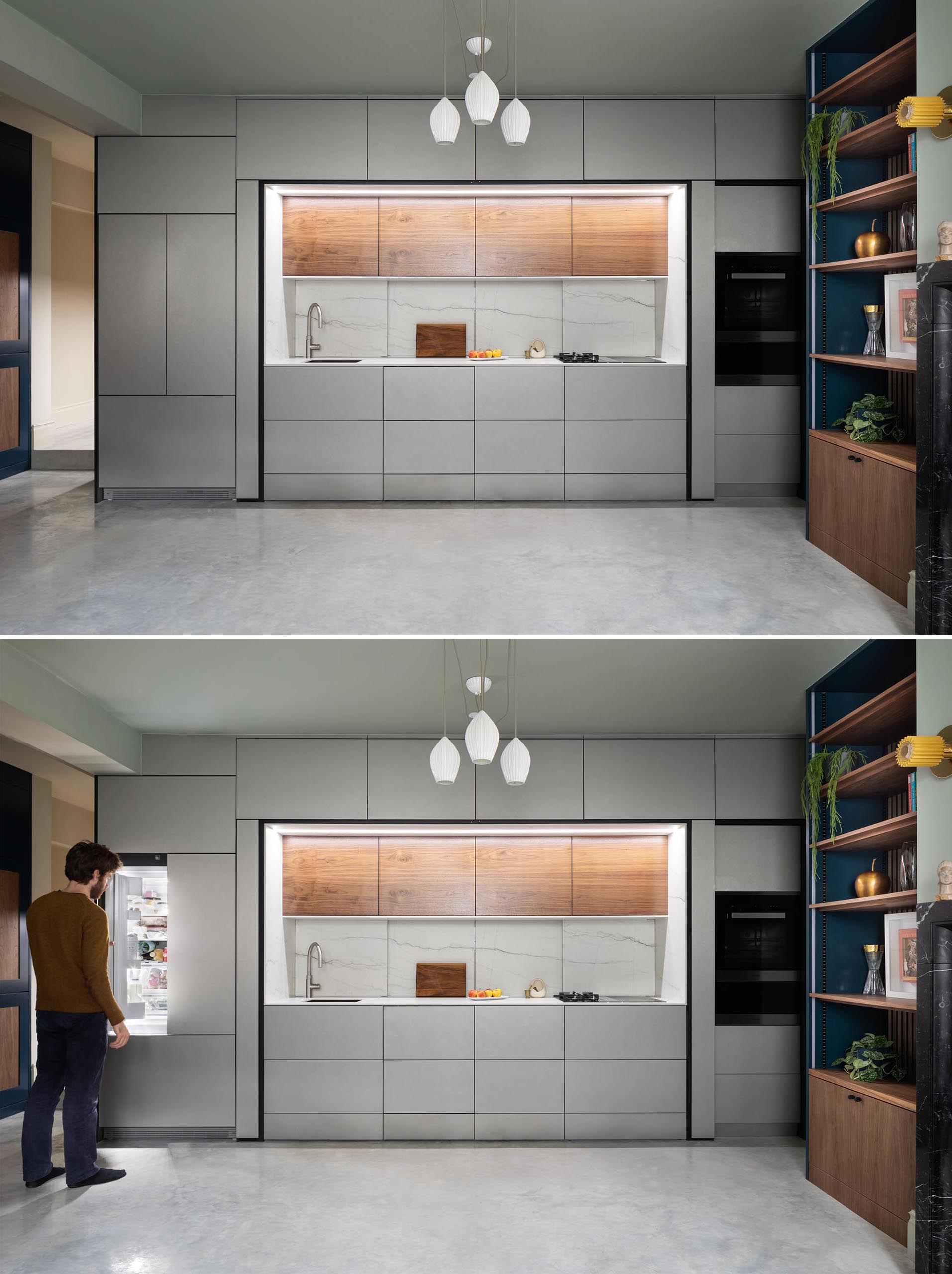 Integrated appliances have also been included, with a wall oven on the right hand side of the kitchen, while the refrigerator is on the left.