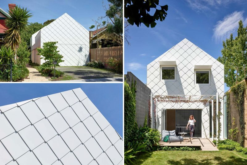 A modern home that is clad in flat lock white metal shingles.