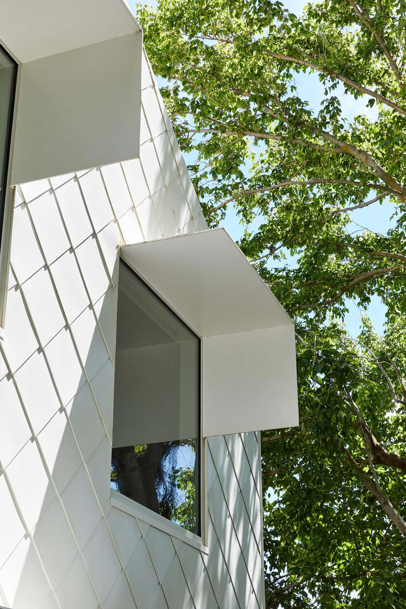 Metal awnings that protrude away from the house provide shade to the interior spaces when it's sunny.
