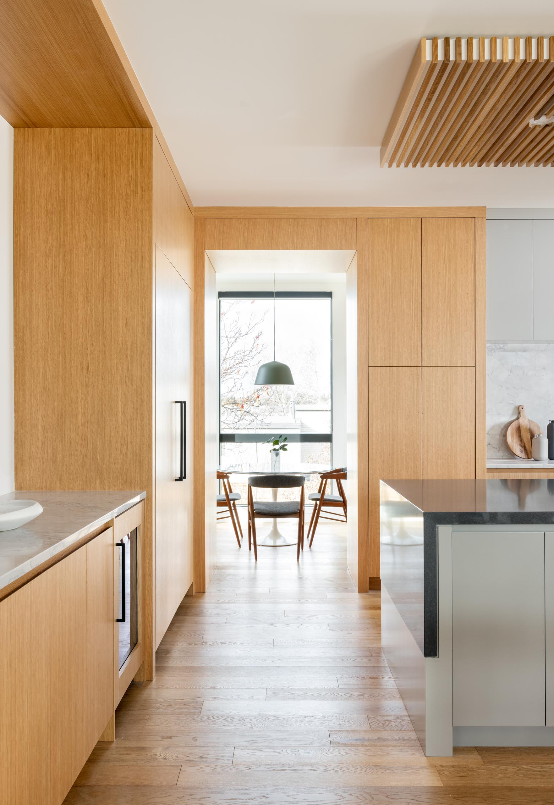 A small breakfast area is located off to the side of this modern kitchen.