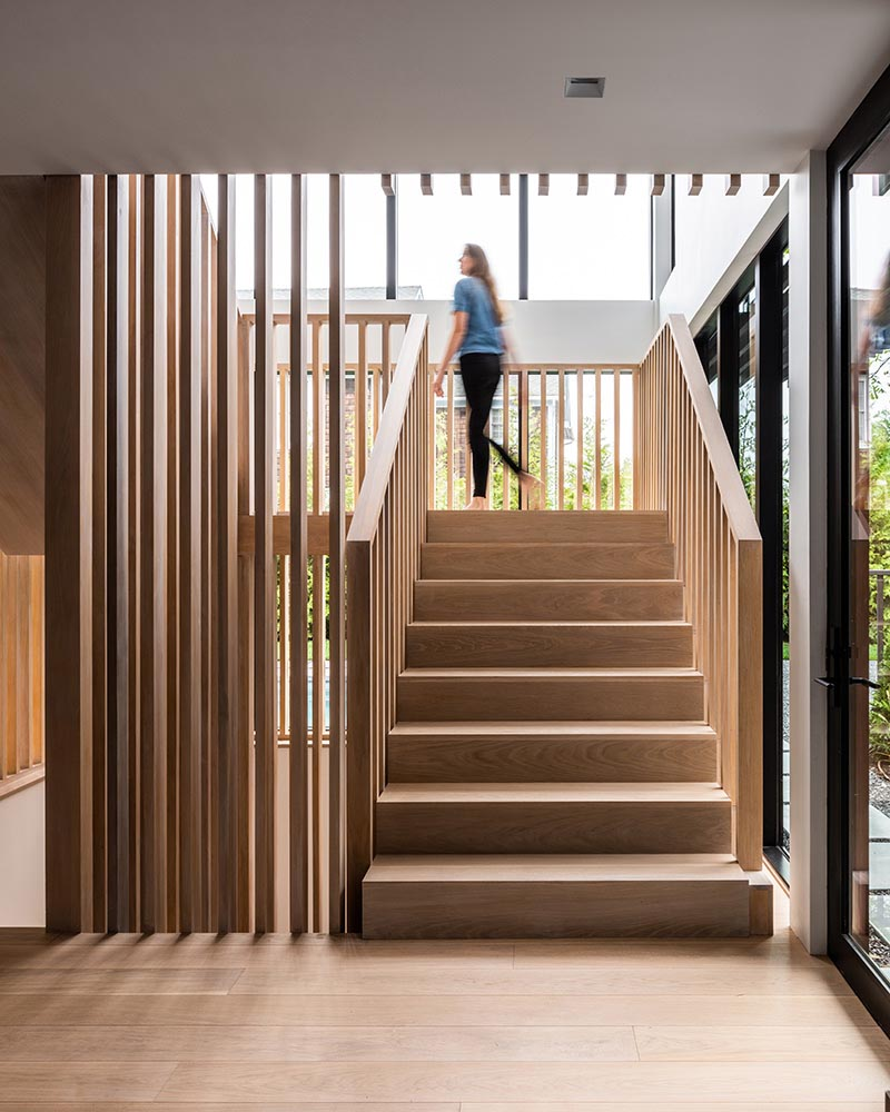 A modern home with wood stairs.
