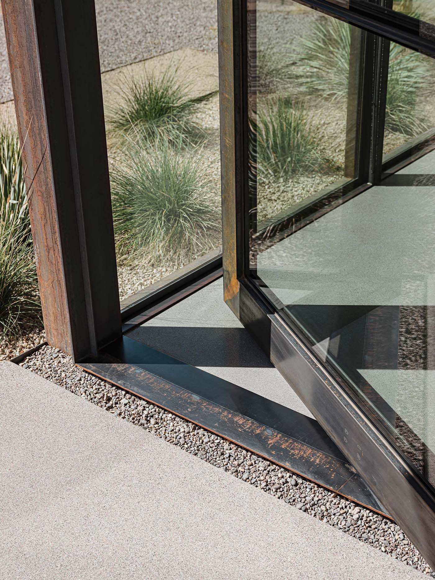 Metal frame for a pivoting door.