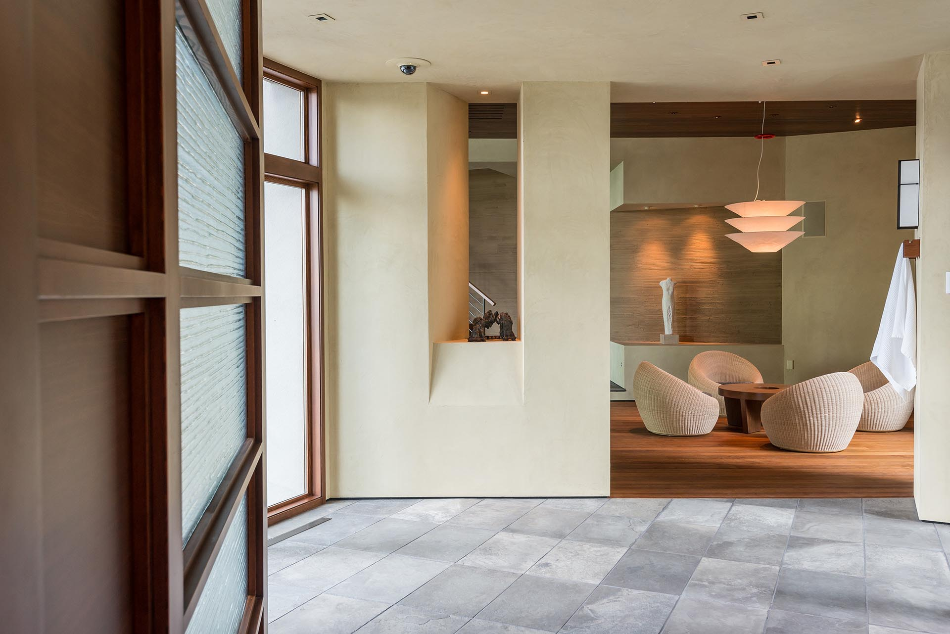 A modern pool house with teak and limestone flooring.