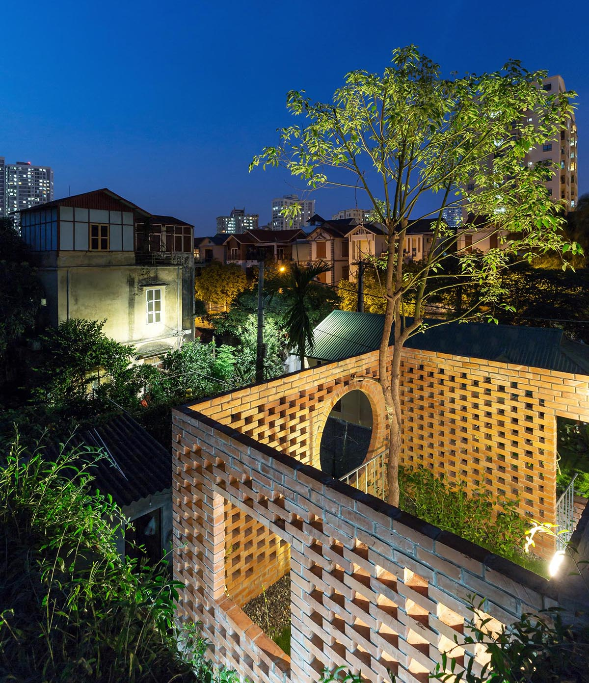 Outdoor lighting makes this rooftop terrace light up like a lantern.