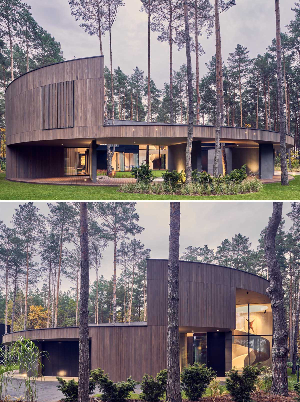 A modern round home with a wood exterior and large windows that provide a glimpse of the interior.