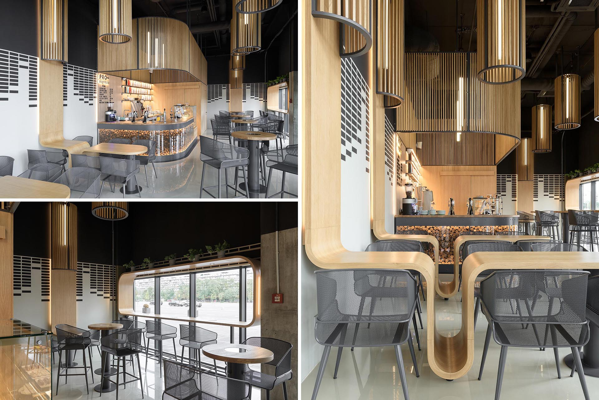 A modern coffee shop with custom designed tables that include space for placing bags.