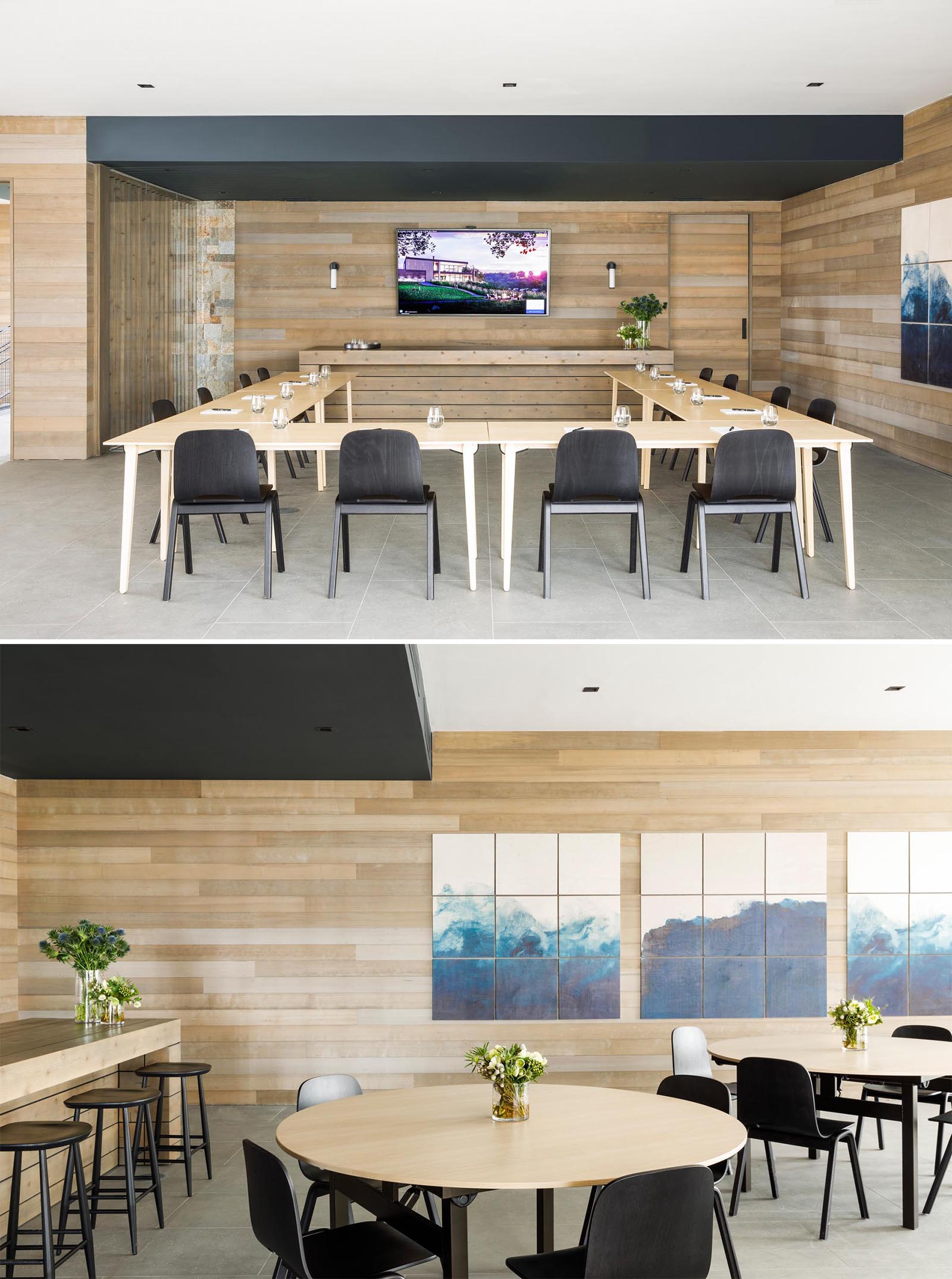 A modern conference room with tables in a U-shaped layout, as well as smaller round tables for more intimate meetings.