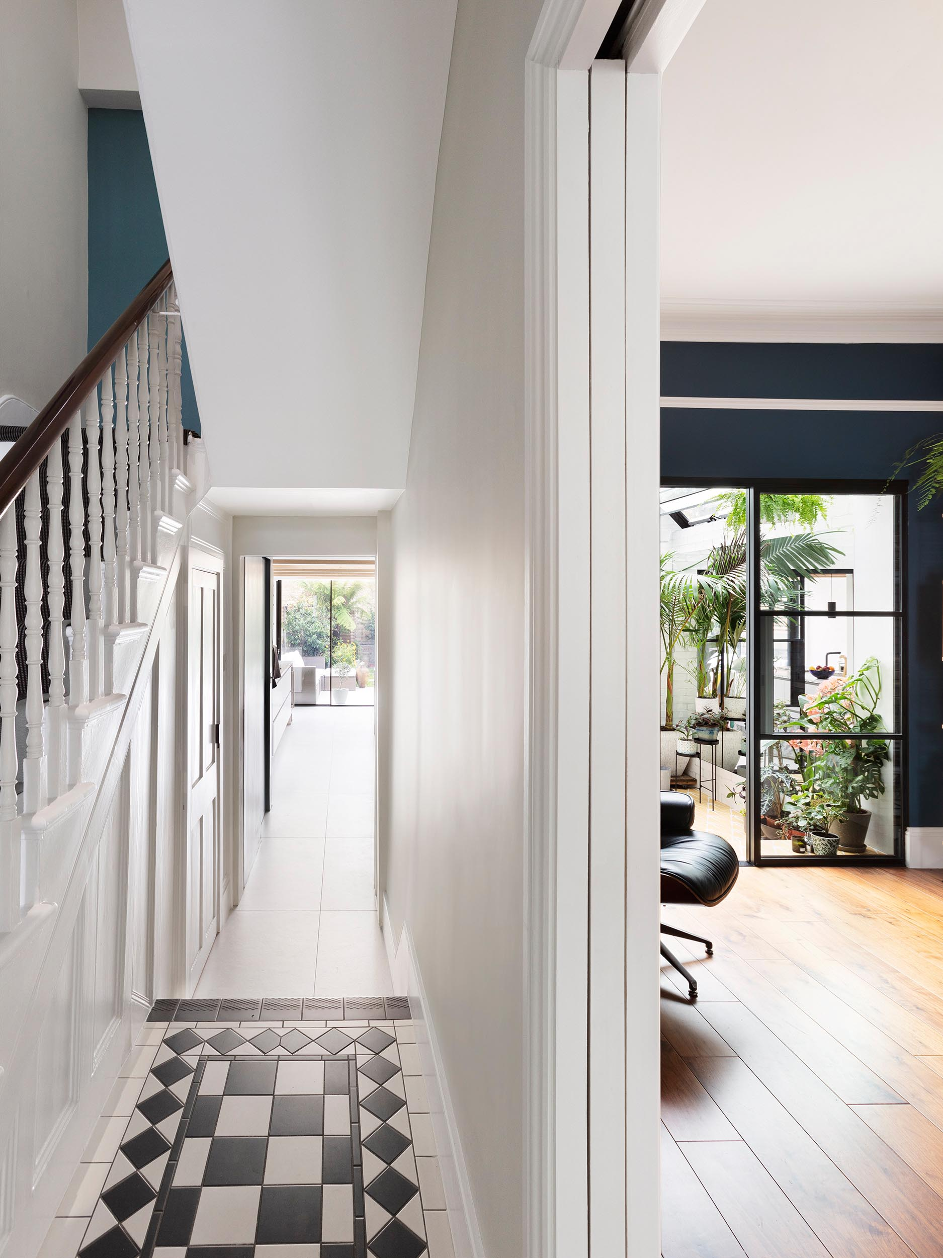 An updated Victorian terrace home with an interior garden room.