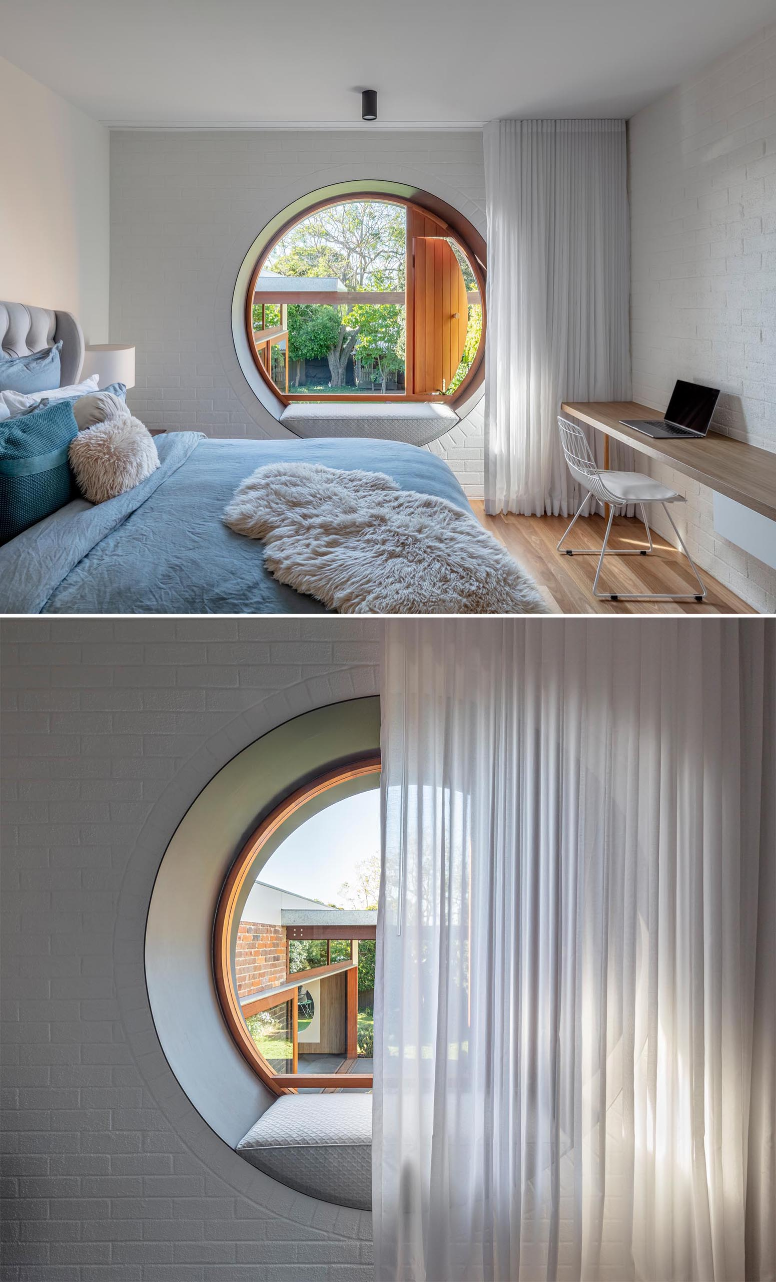 A modern bedroom with a desk and round window with a built-in bench.