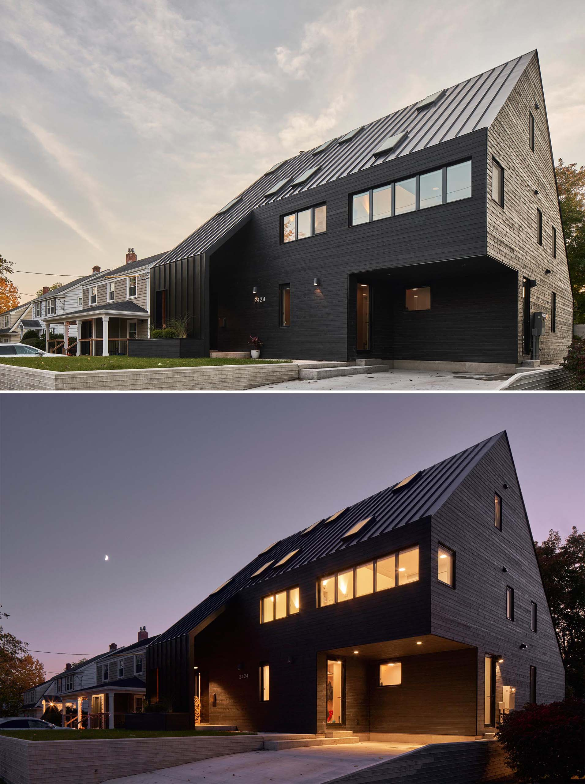 A modern black house with wood siding and a standing seam metal roof, as well as black window frames.