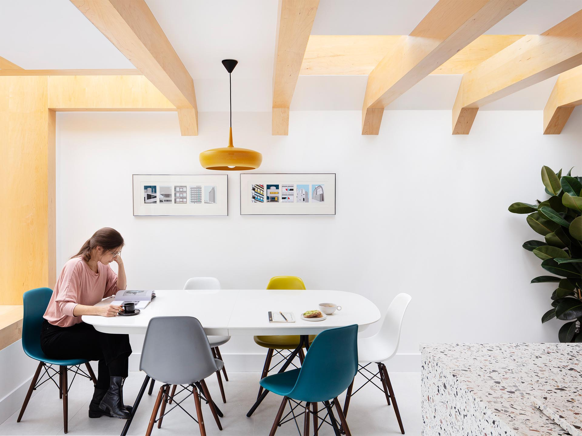 Warm wood beams are clearly visible against the white walls of the dining area.