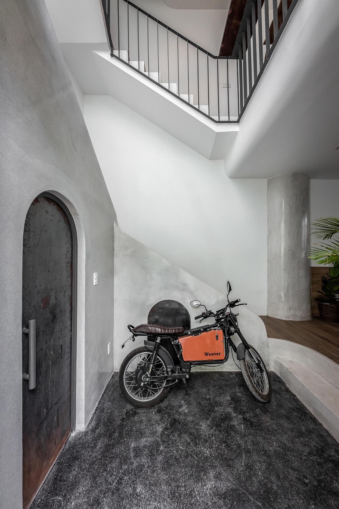 A modern entryway with room for motorbike storage.