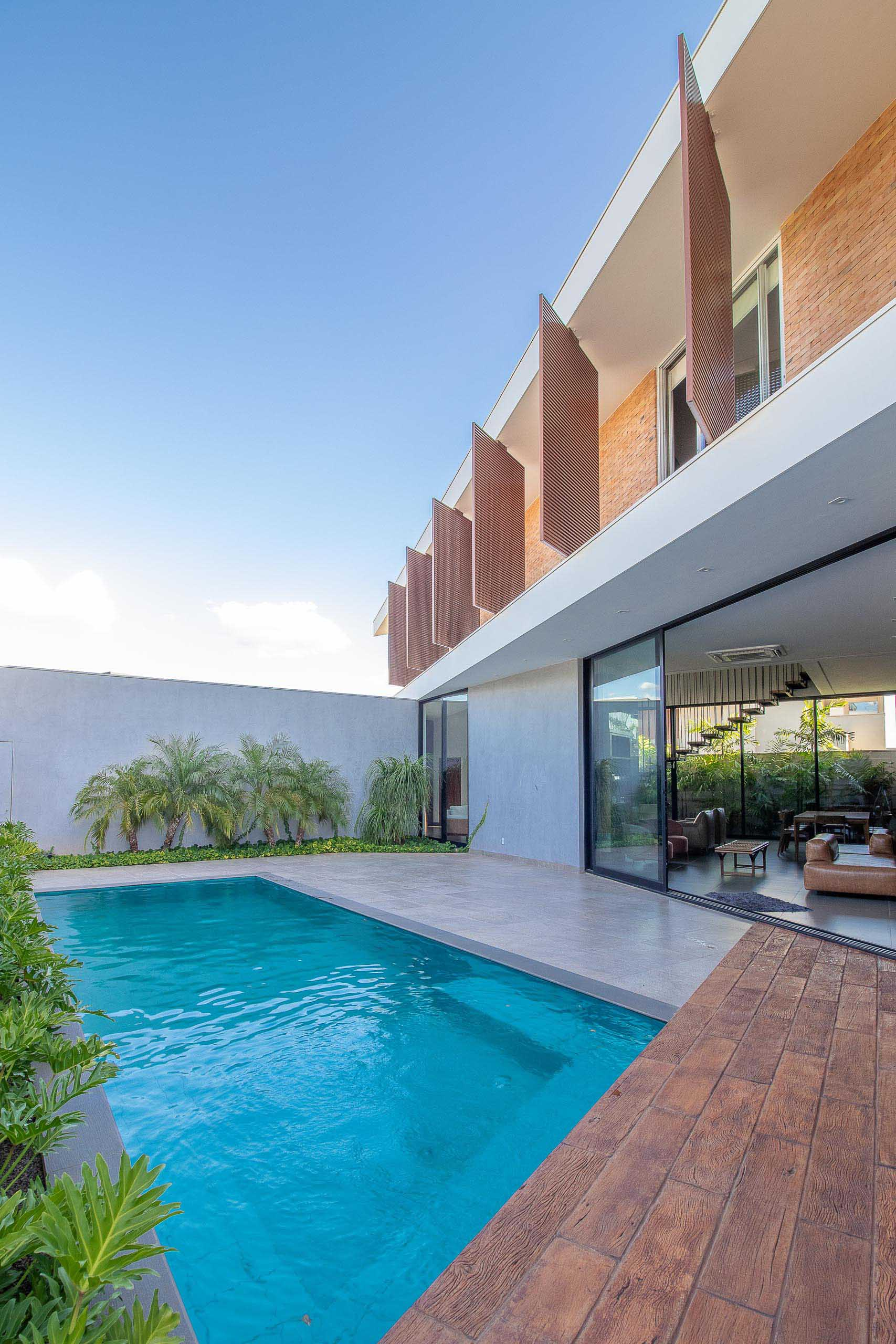 A modern house with a swimming pool and patio.