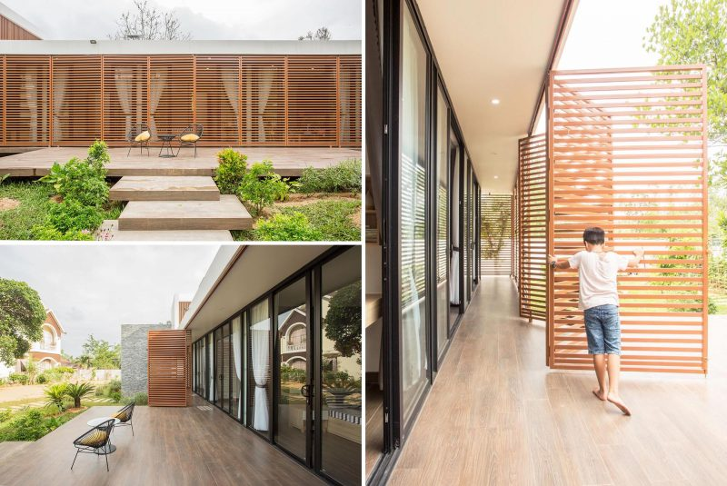 A modern house with operable metal screens that wrap around the exterior and provide an outdoor corridor.