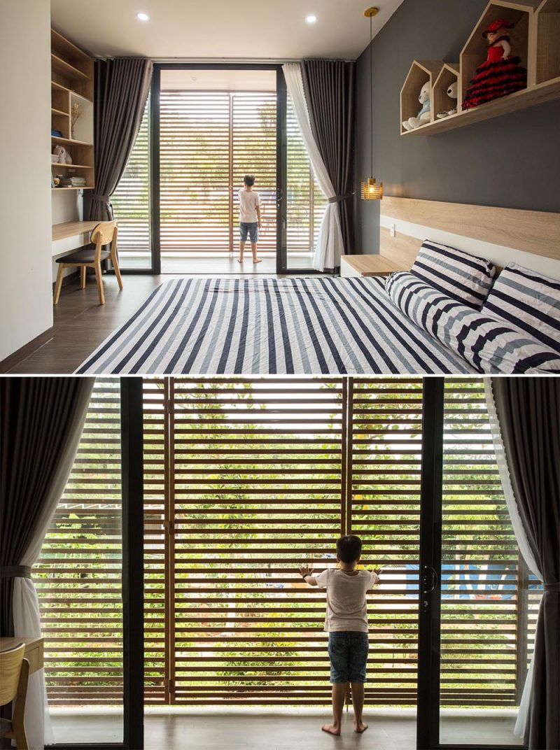 A modern kids bedroom that opens to an outdoor corridor with metal screens