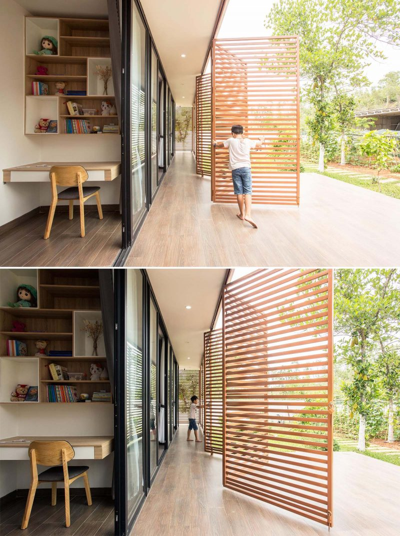 A modern house with operable metal screens that wrap around the exterior and create an outdoor corridor.