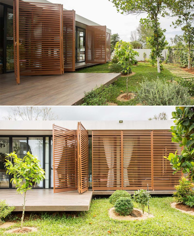 Moveable metal screens can be opened to allow the interior spaces access to the garden.