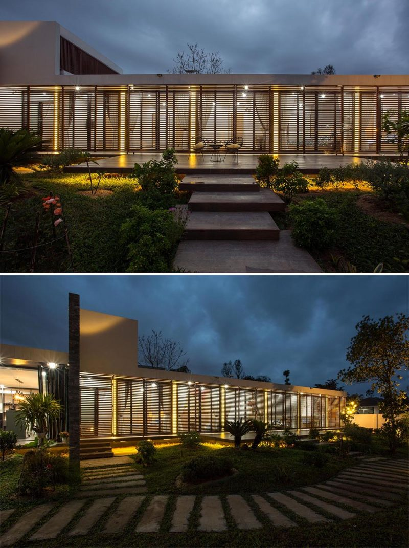 At night, the light from within the rooms, as well as dedicated vertical lights at the end of the interior walls, shine brightly through metal screens, giving this home a lantern-like appearance.
