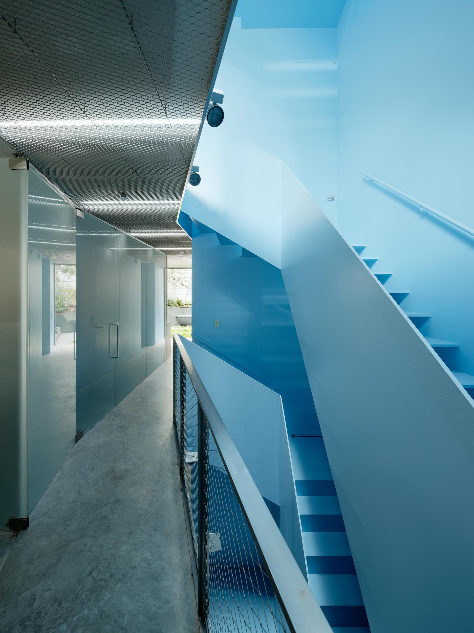 A modern home with a pastel blue staircase.