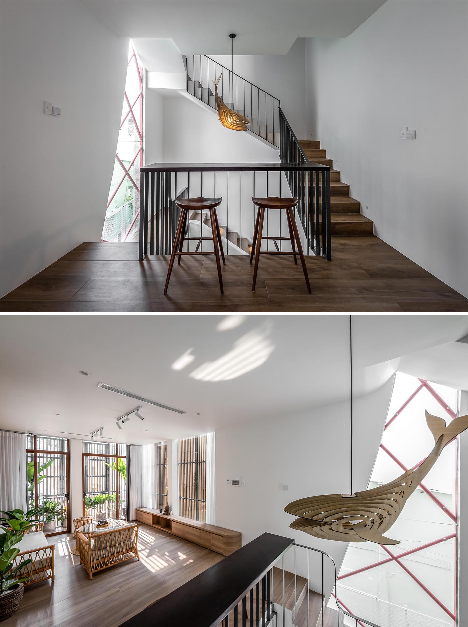 Before reaching the living room of this modern home, there's a small bar area built into the design of the black handrail. From this angle, you're able to see the wood wall sculpture light that hangs from the ceiling.