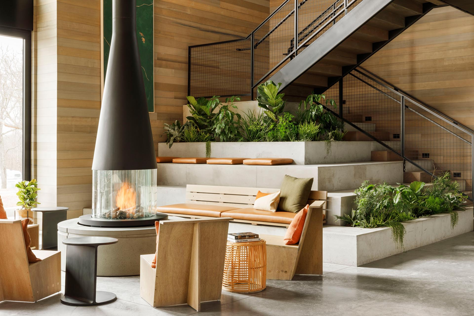 Tiered seating, created as an extension of the stairs, includes built-in planters.