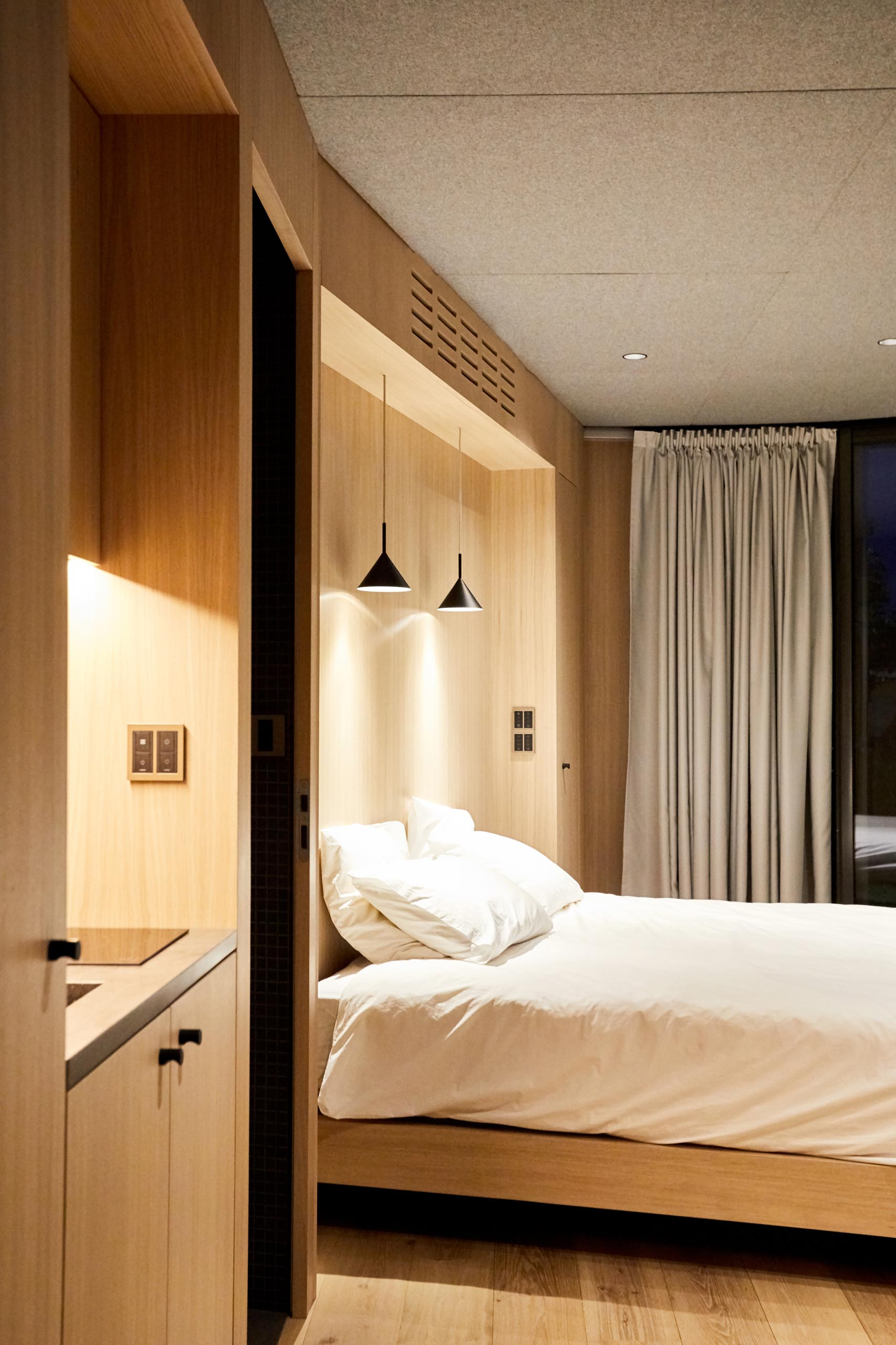 Inside the LumiPod, there's a bedroom, a kitchen area, a dining area, a bathroom, and a built-in wardrobe.