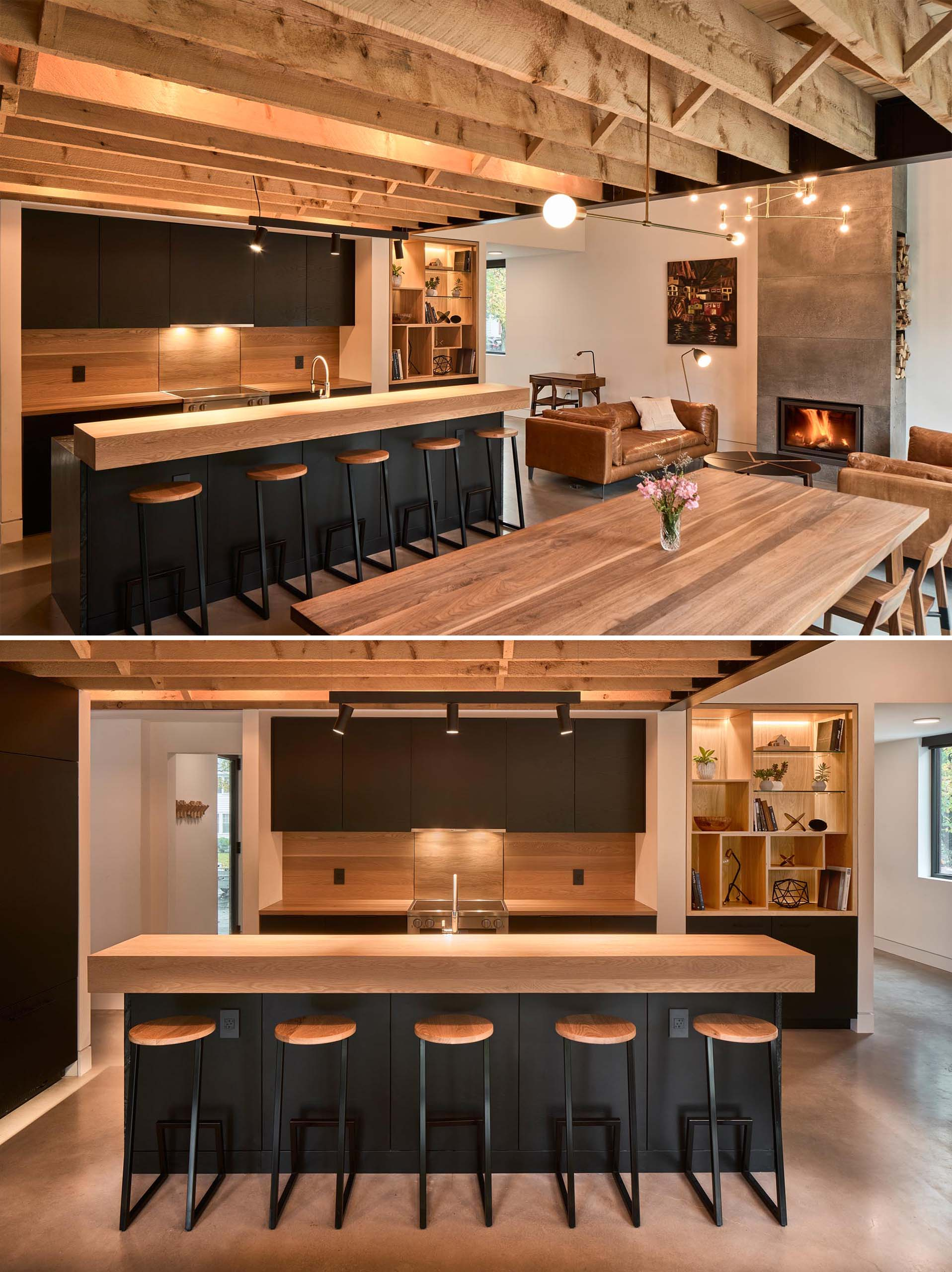 A modern open plan interior with a fireplace in the living room, a dining area, and a kitchen with matte black cabinets.