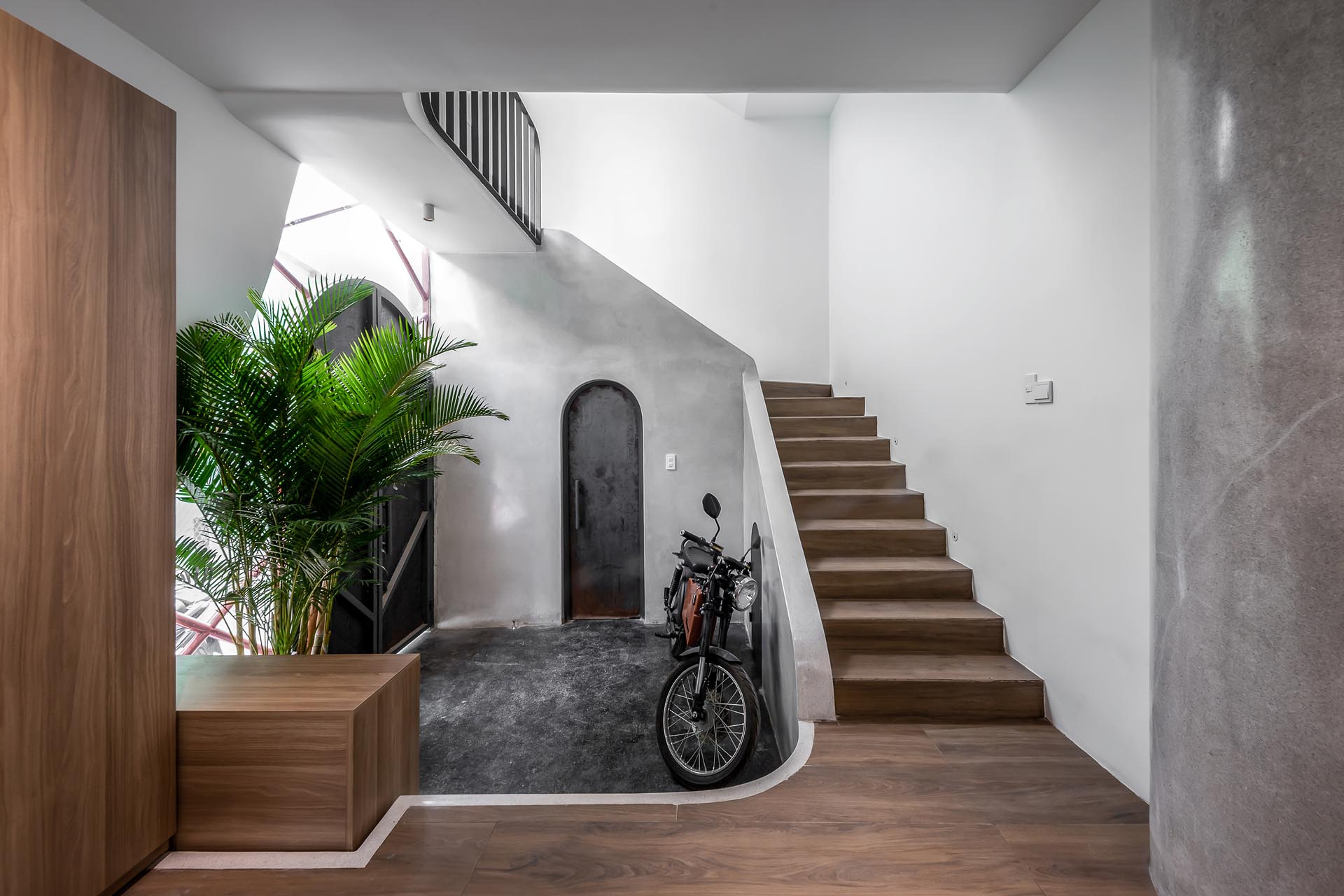A modern home with a slightly stepped down entryway next to the stairs.