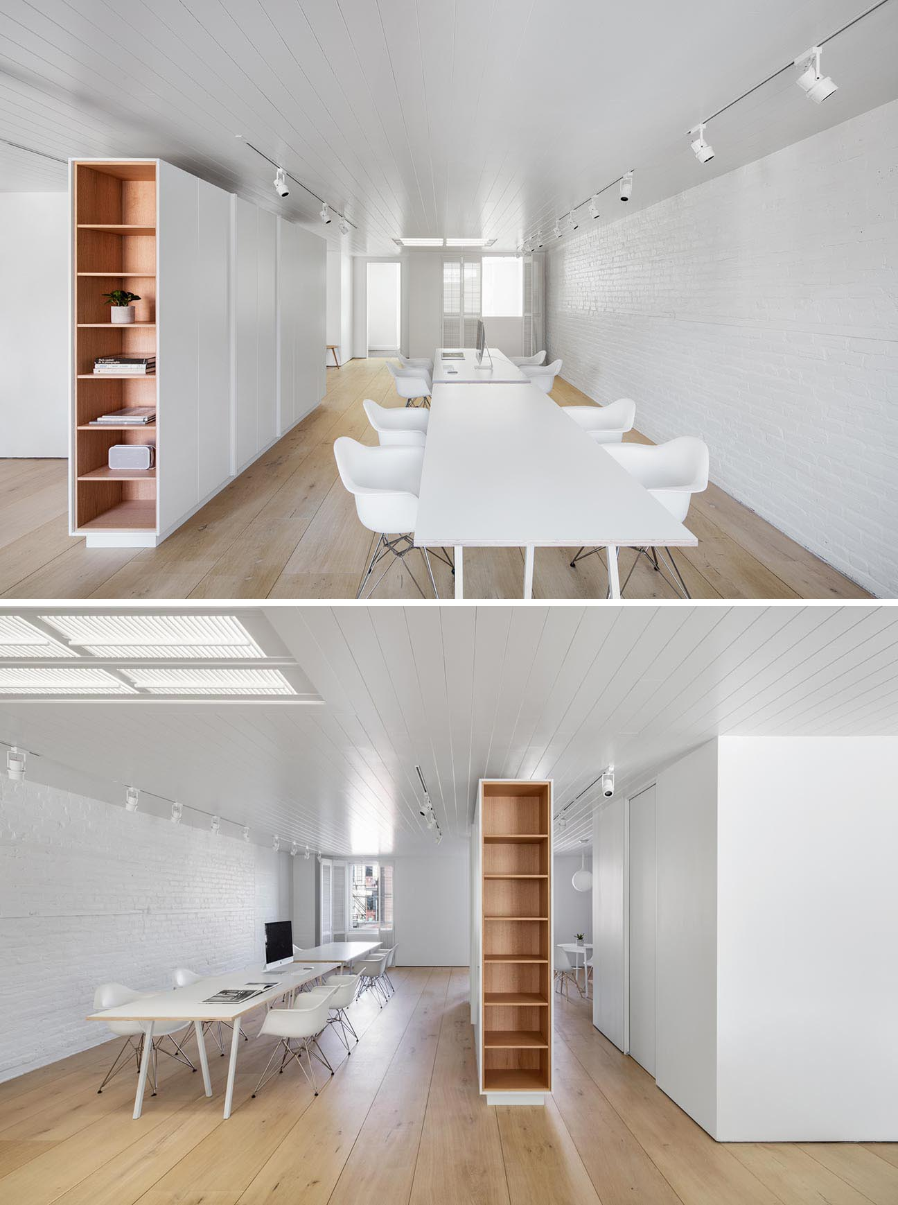 A modern office with wood lined shelves and wood floors.