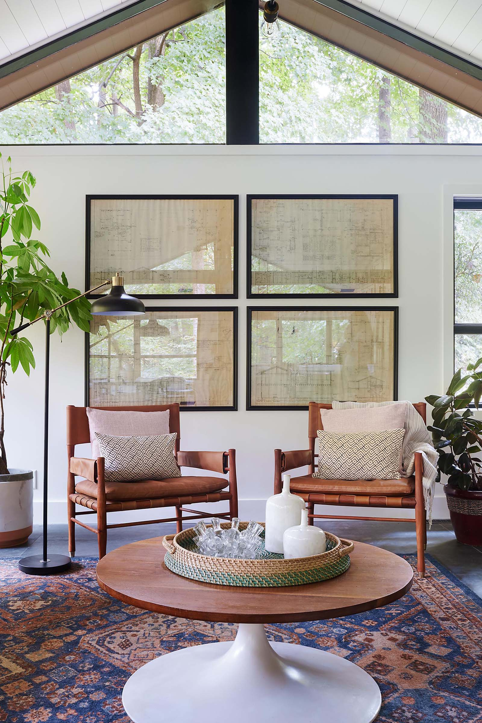 A modern living room with black framed art.