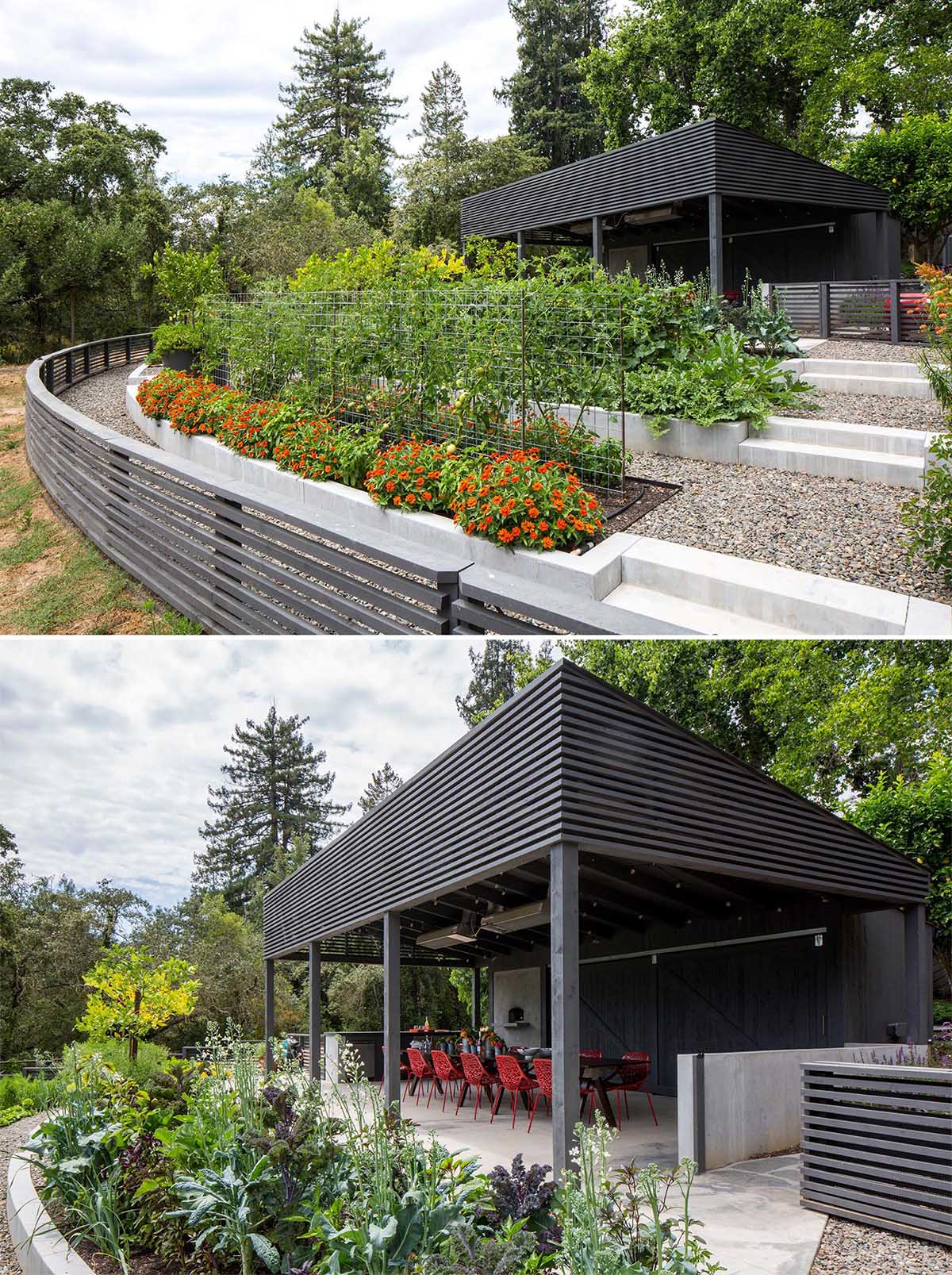 A modern garden with an covered outdoor dining area and terraced built-in planters made from concrete.