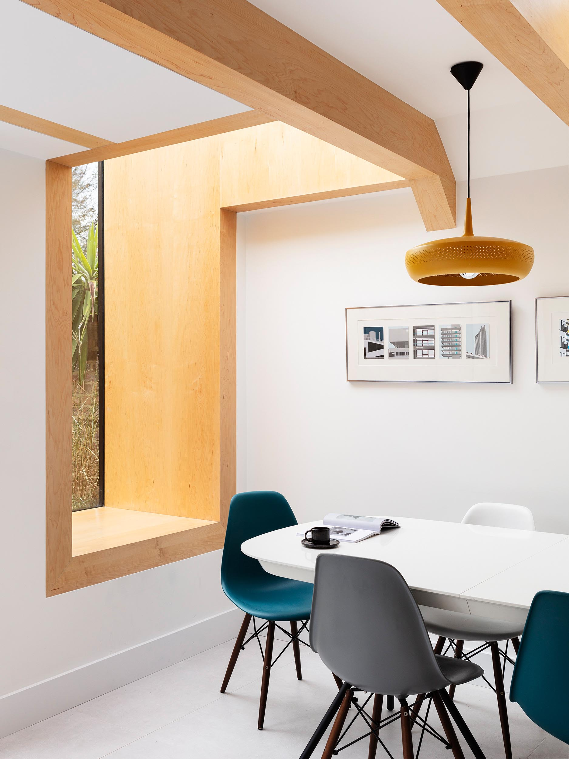 A deep set window seat lined with the same Oak wood as the beams,  has views of a fish pond.