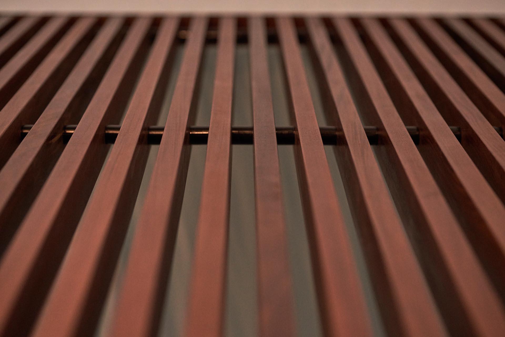 A closeup look at a wood slat wall.