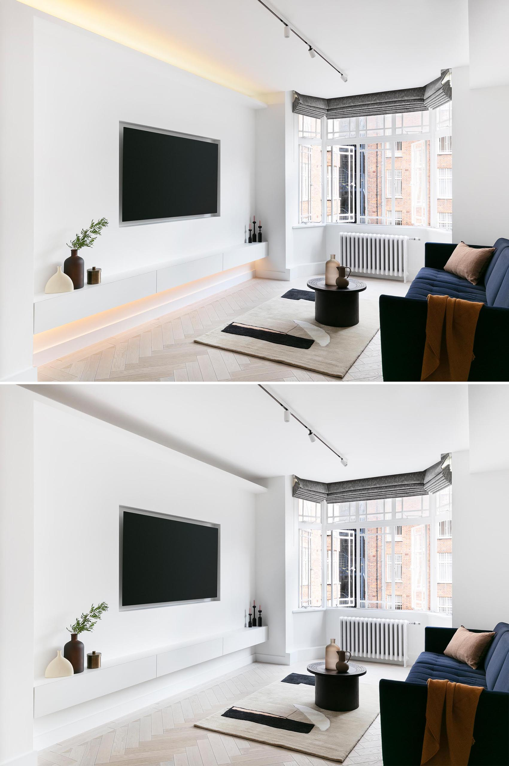 To create the bright spaces and clean lines, the designers went with crisp white walls and added in LED lighting to highlight the straight edges, like in the living room, also also includes a recessed television and floating storage cabinet.