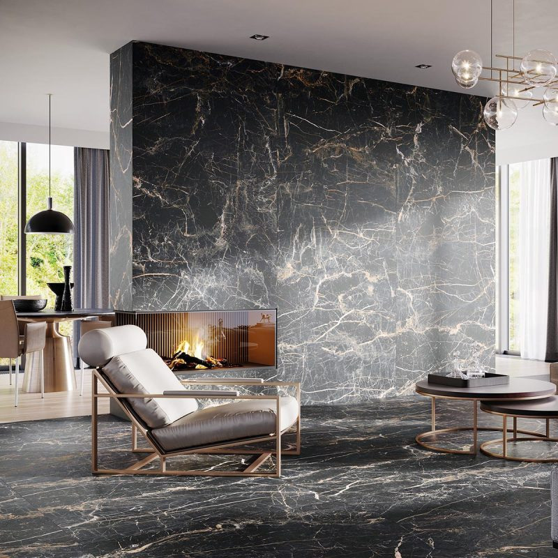 A tile collection with abundantly scattered gold veining patterns, inspired by the grandeur of marble.