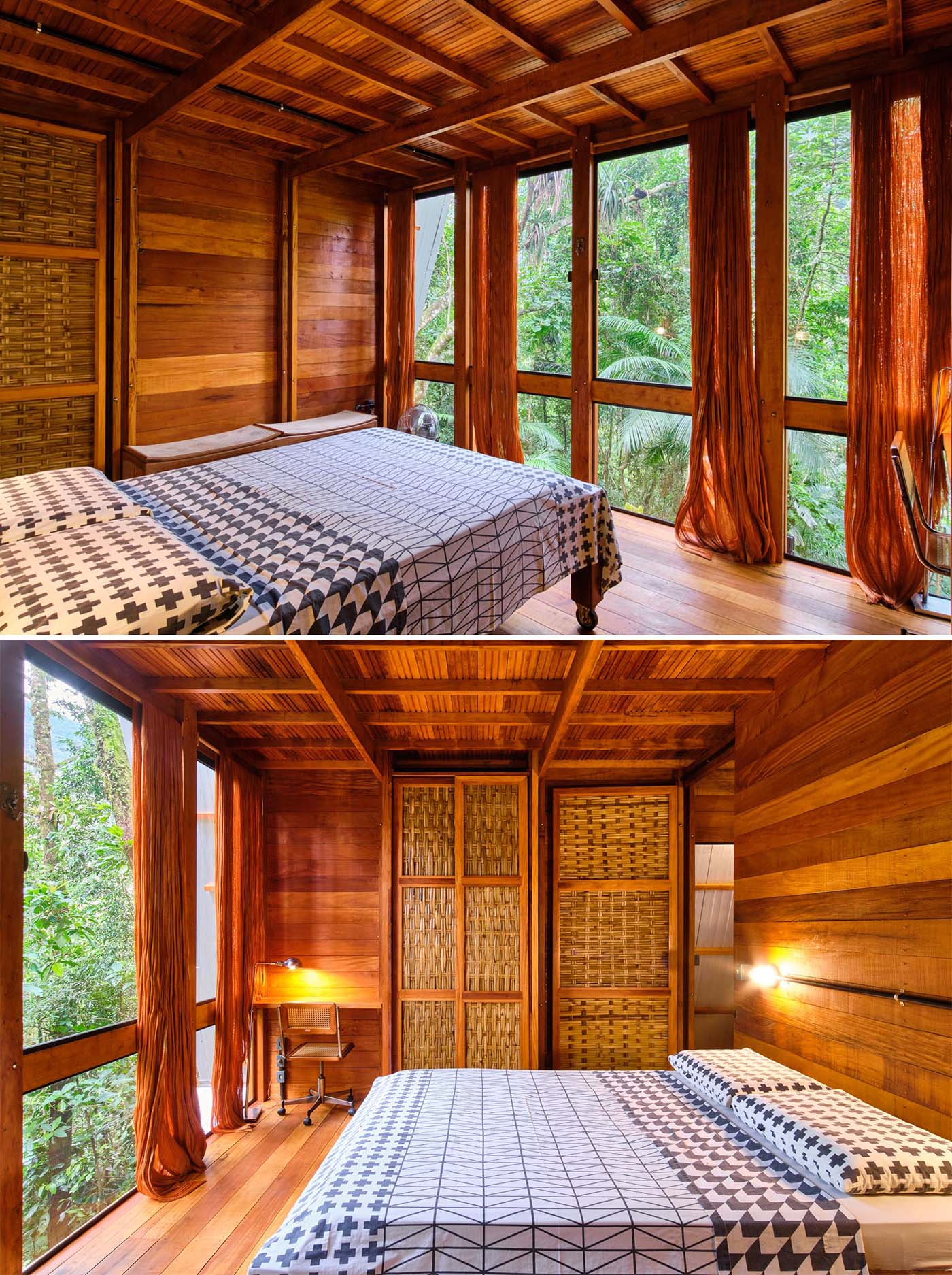 The bedroom of an A-frame cabin with a warm wood interior and floor-to-ceiling windows.