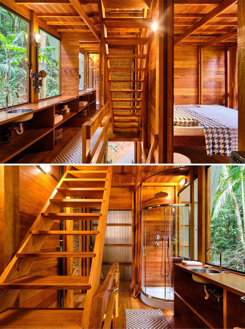 The bedroom and bathroom of an A-frame cabin with a warm wood interior.