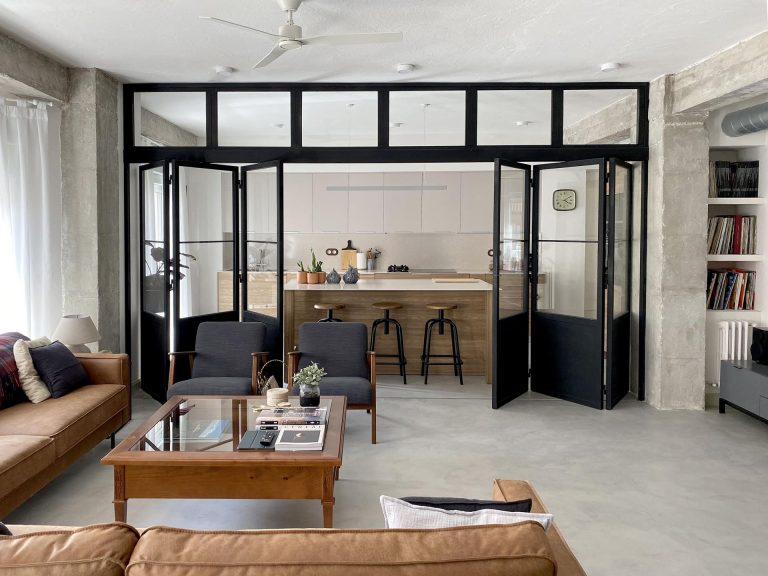 Black-Framed Doors With Windows Enclose The Kitchen But Not The Natural Light