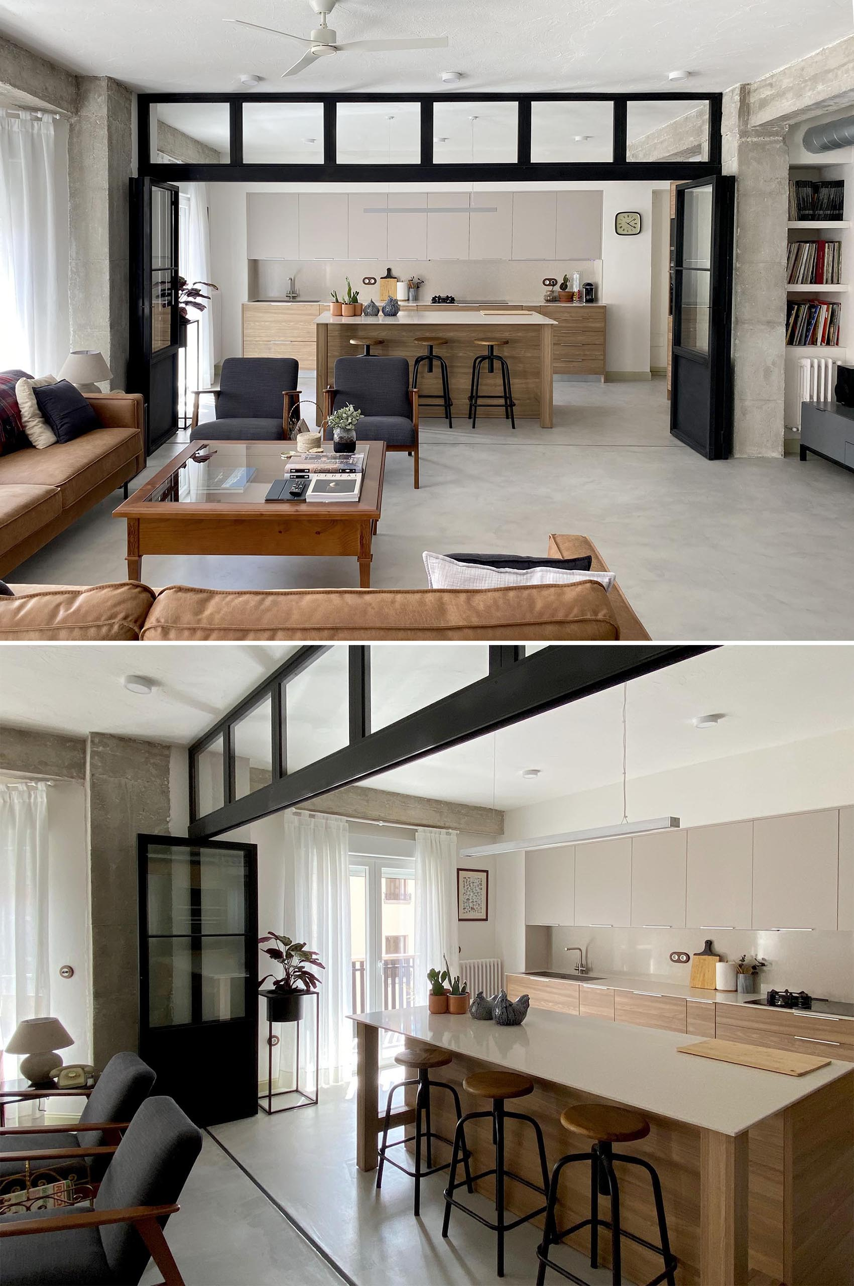 The folding black-framed glass doors sit below a row of windows, and when open or closed, the doors allow the natural light from the windows in the the exterior wall to travel throughout the interior.