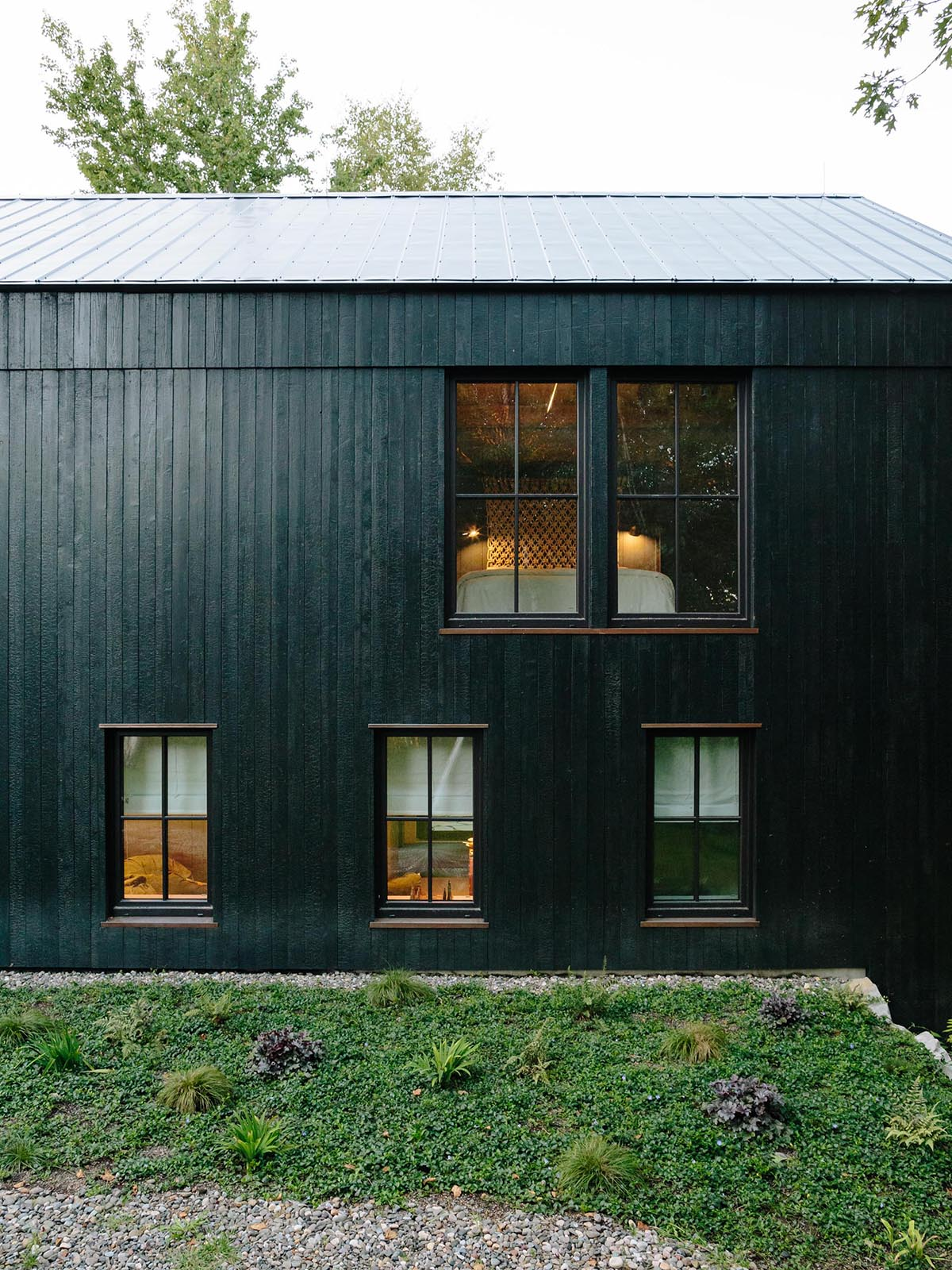 A large cabin-style home with charred cedar siding.