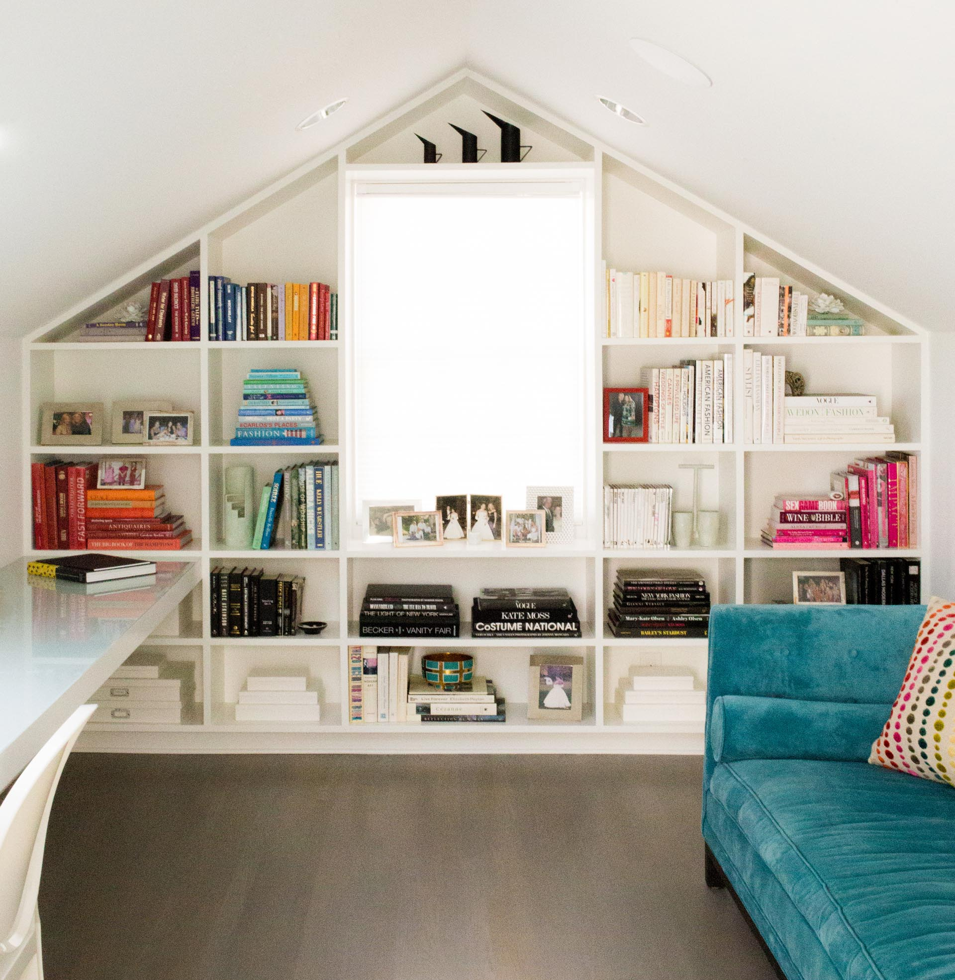 The focal point of this home office is the custom bookshelf that fills the entire wall and wraps around the window.