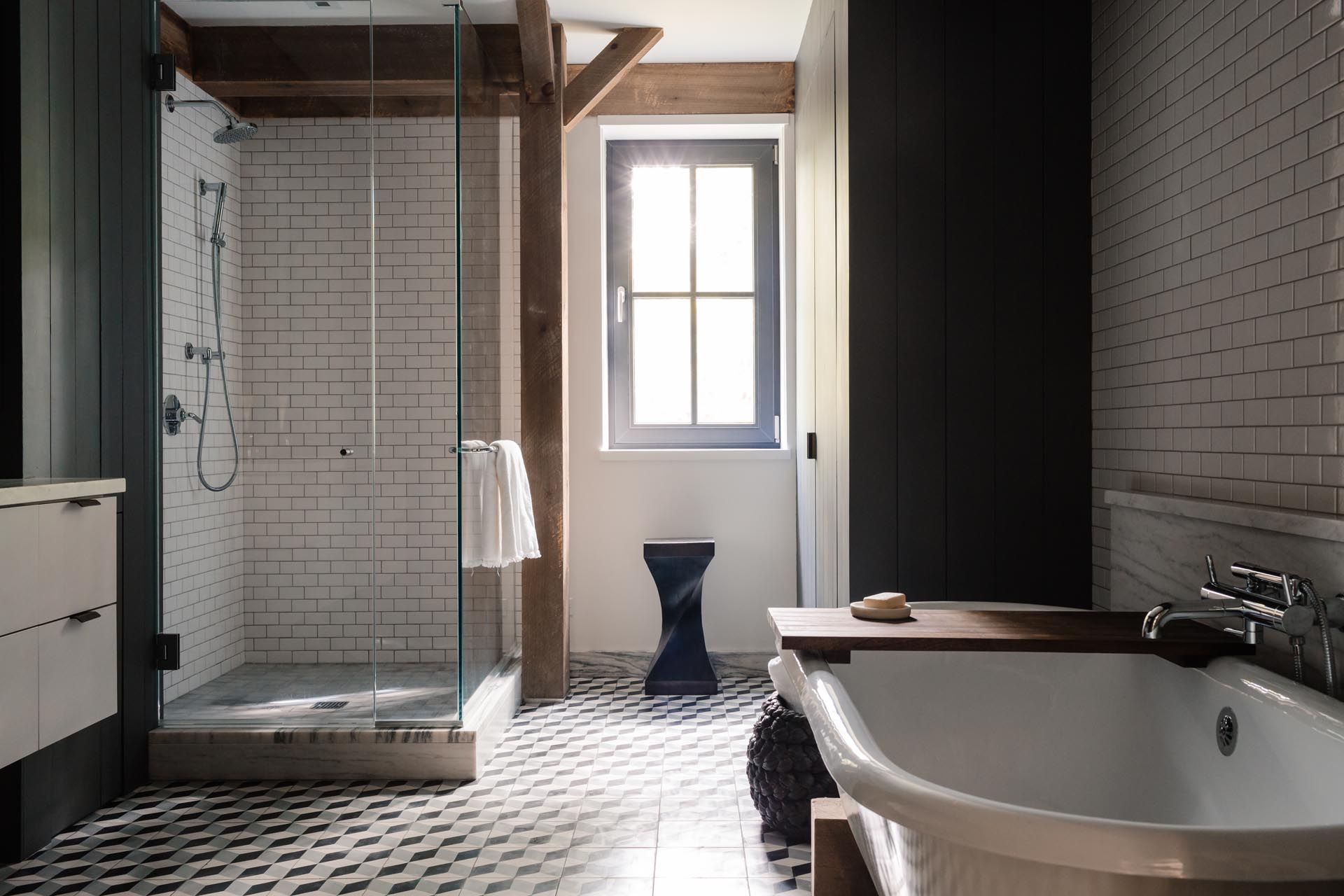 A contemporary bathroom with a glass-enclosed shower and a freestanding bathtub.
