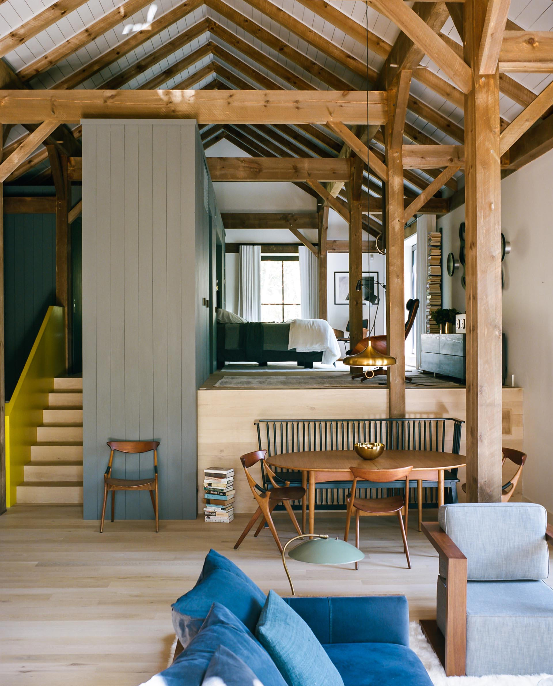 The multi-level interior of a barn-inspired home.