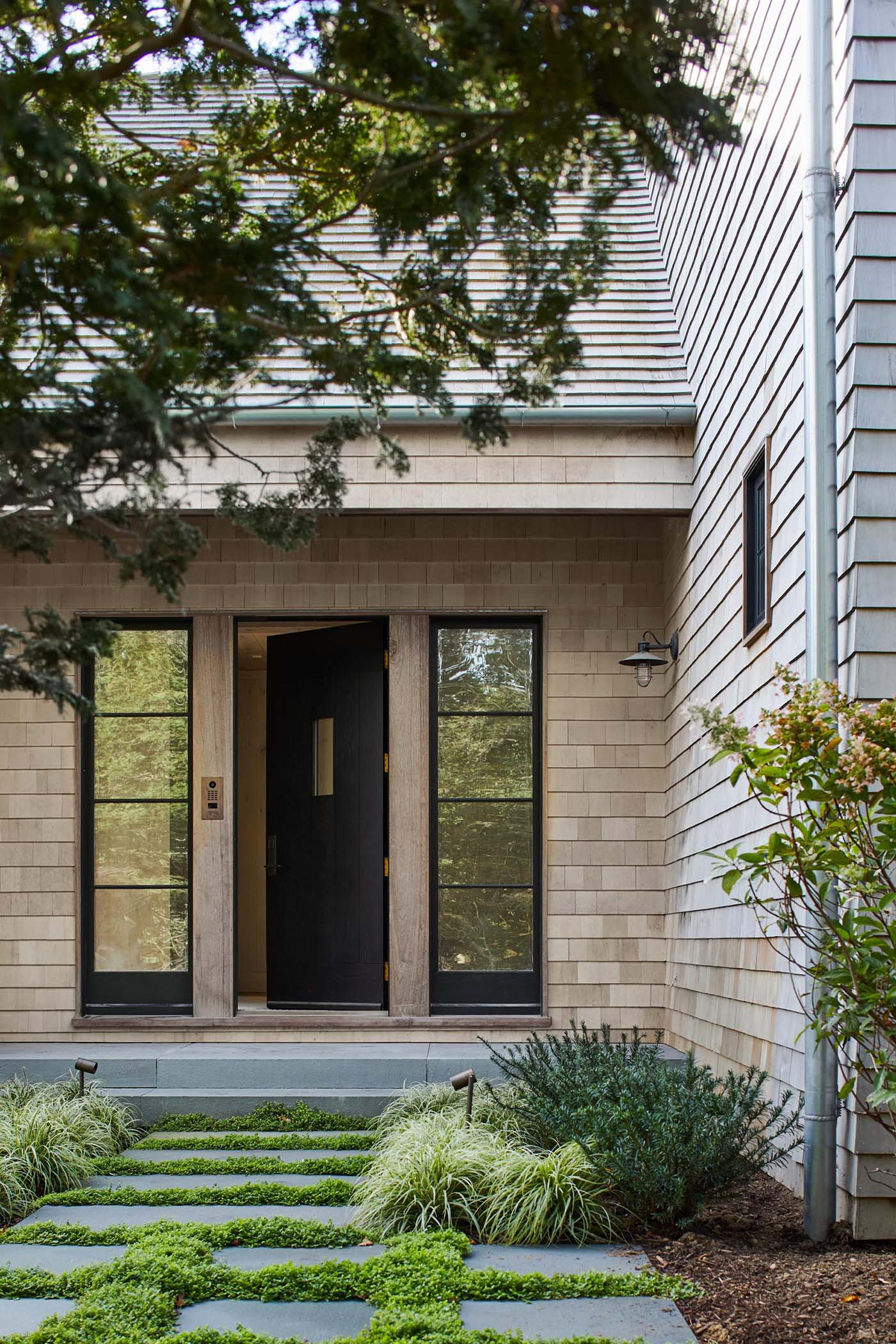 Welcoming visitors to this home is a custom designed front door crafted by a local mill worker.