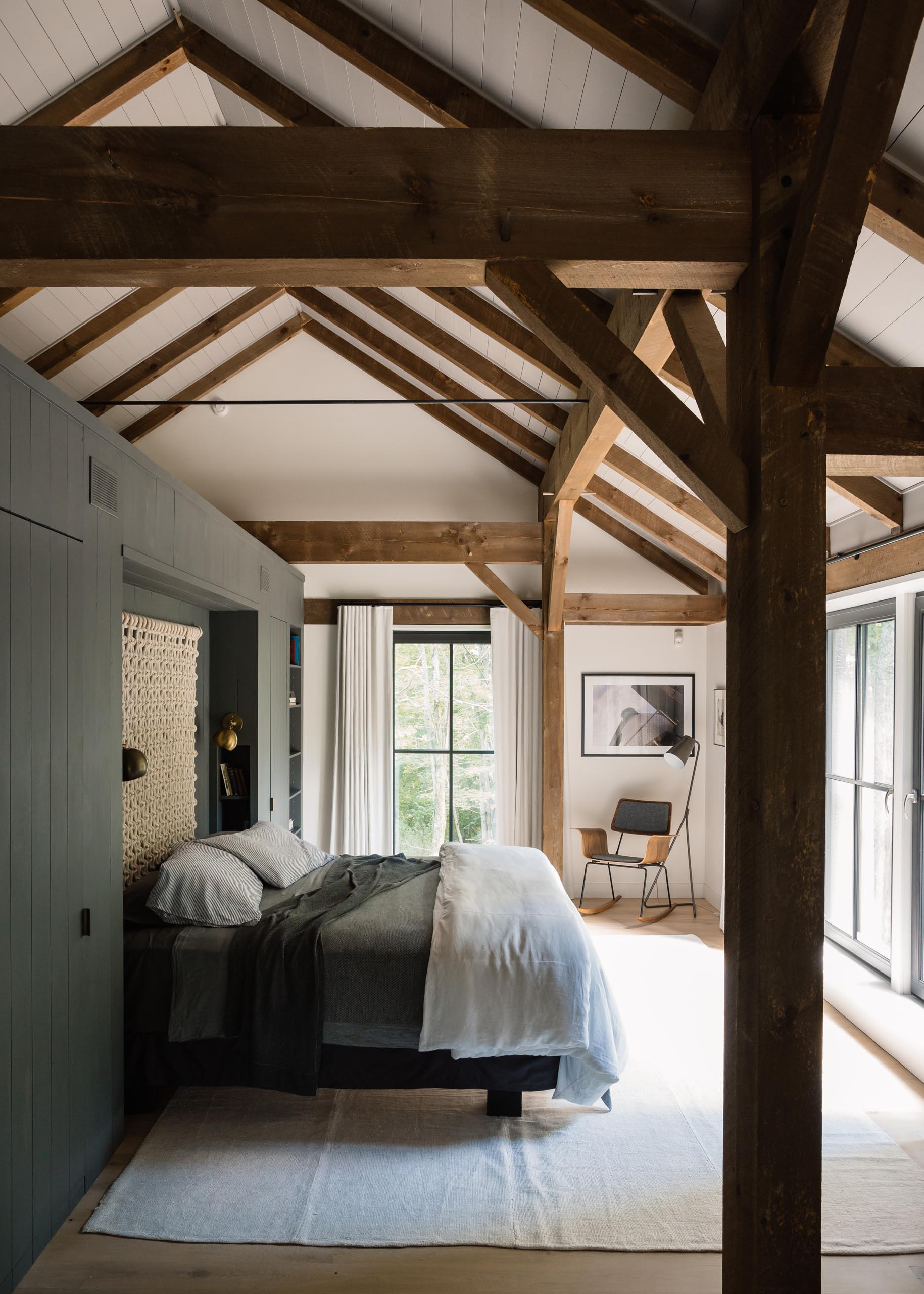 A modern barn-inspired bedroom with exposed wood.