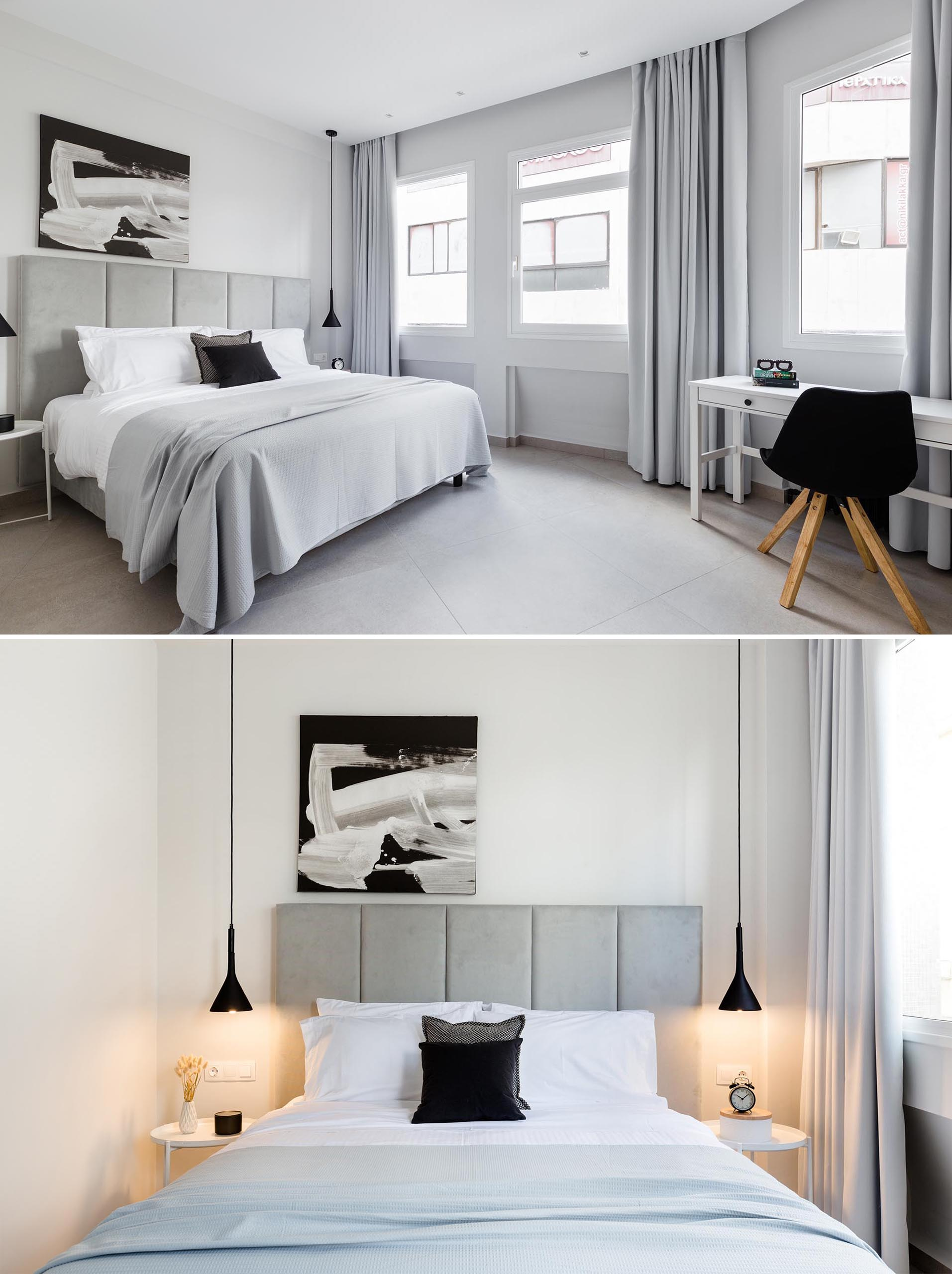 A modern bedroom where the color palette is filled with grays, black and white. At night, the pendant lights beside the bed add a warm glow.